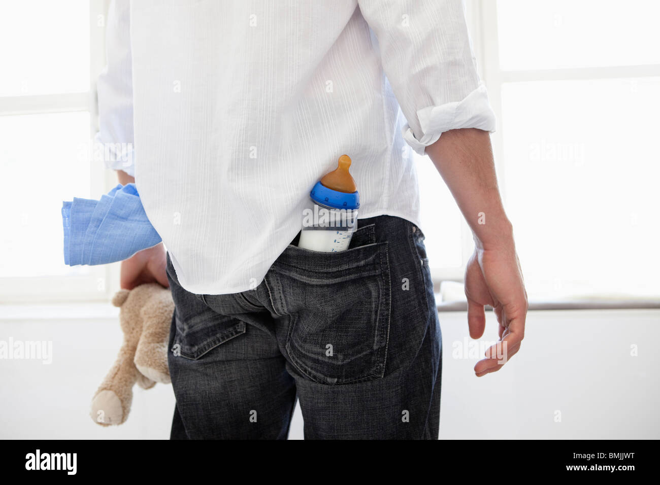 Man having baby-things in his pockets - Stock Image