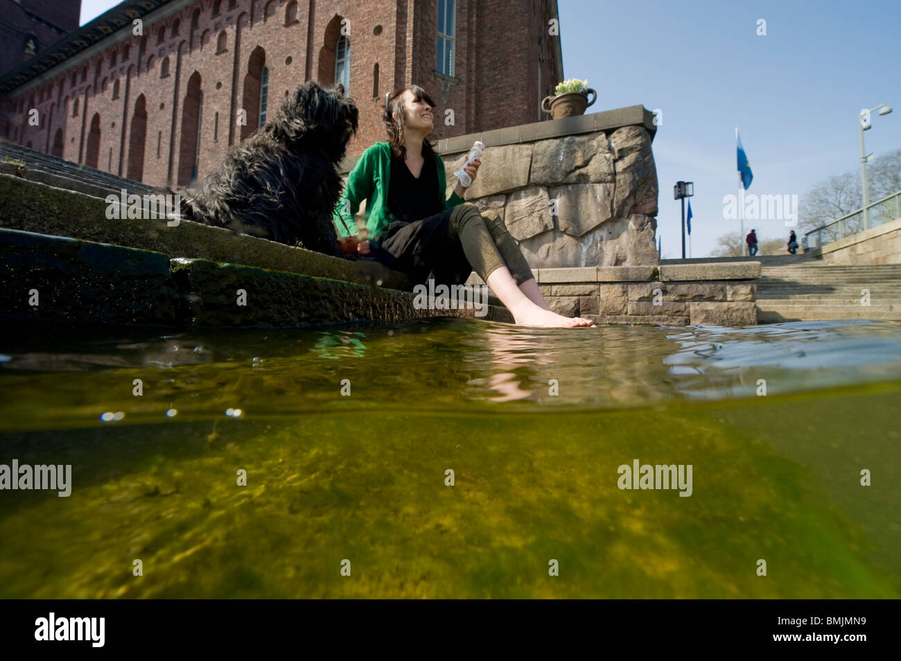 A woman and a dogat city hall Stockholm - Stock Image