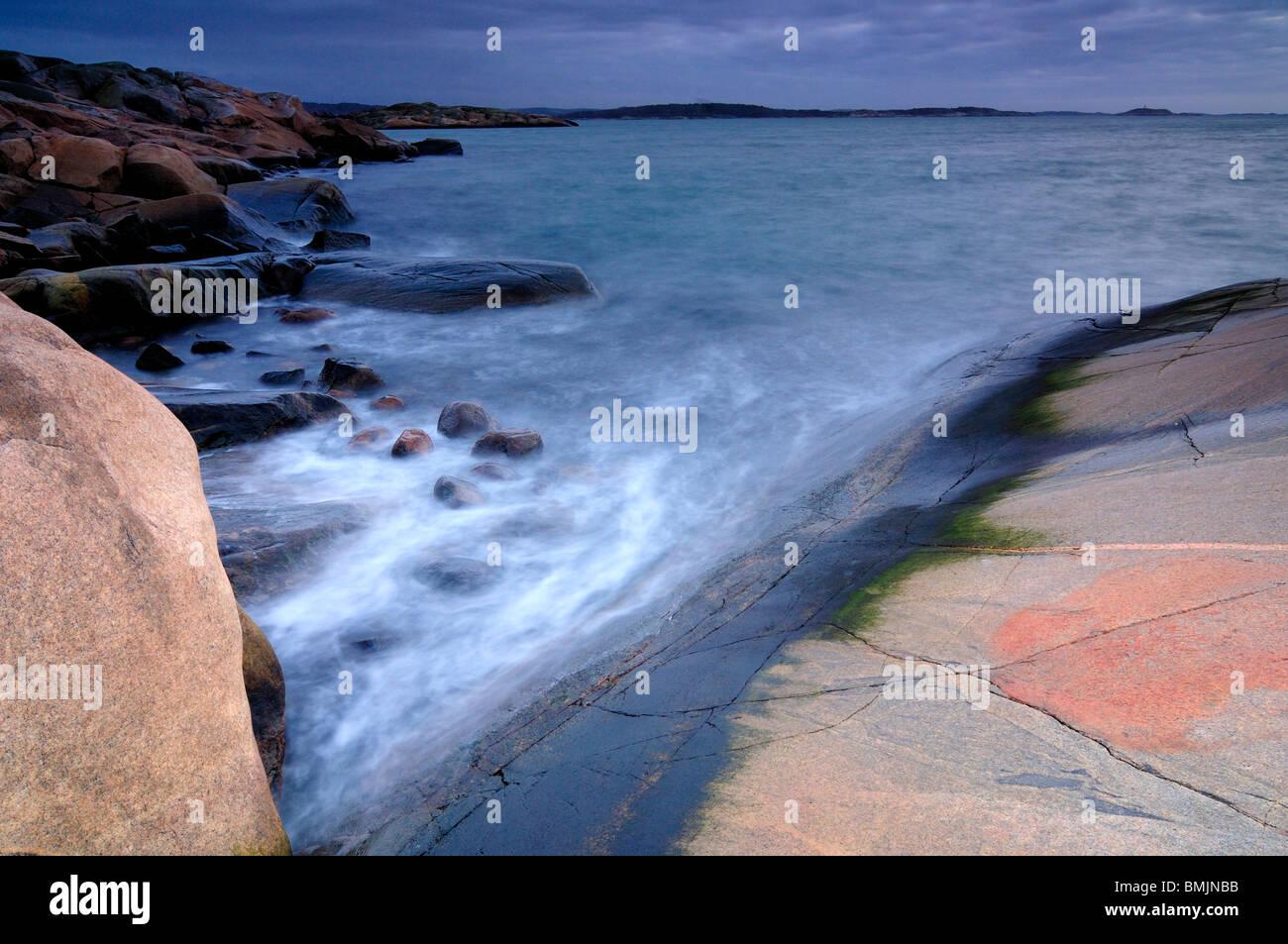 Flat rocks at the ocean - Stock Image