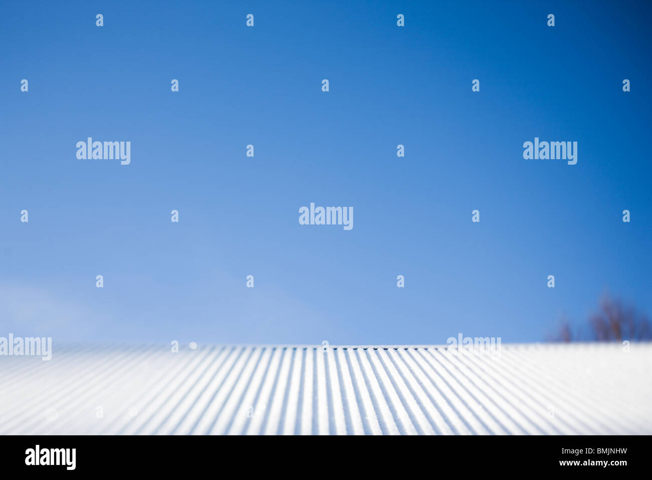 Scandinavian Peninsula, Sweden, Skane, Snow covered roof against sky - Stock Image