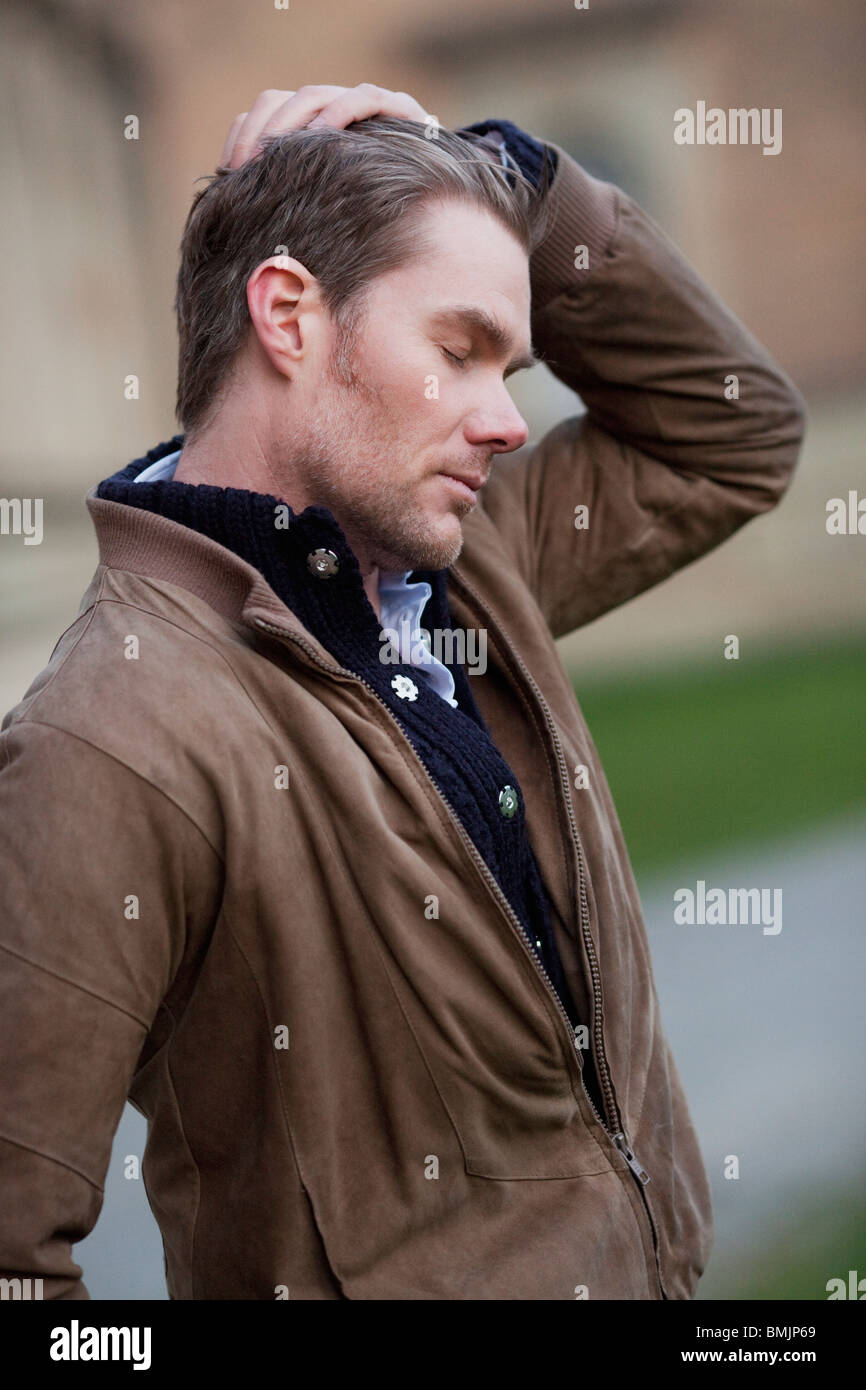 Man stroking through his hair Stock Photo