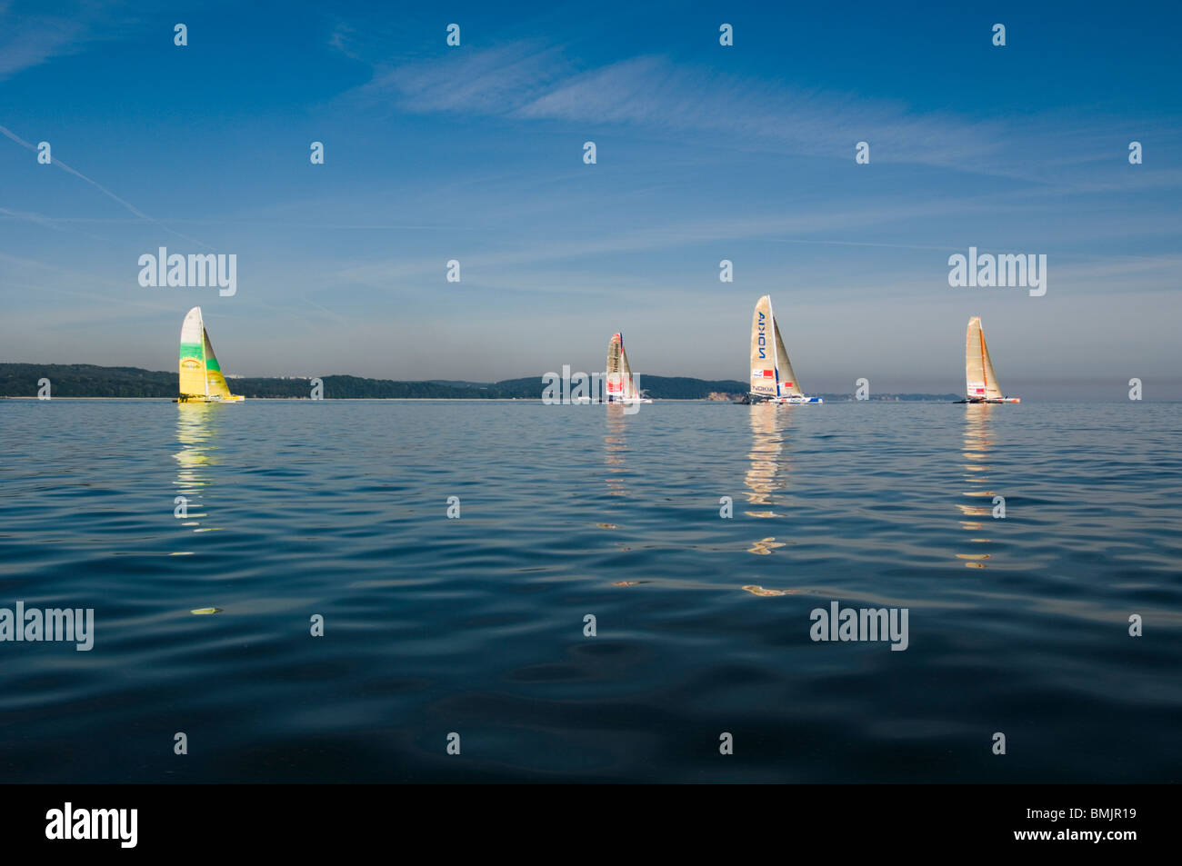 Sailboats on a calm ocean - Stock Image