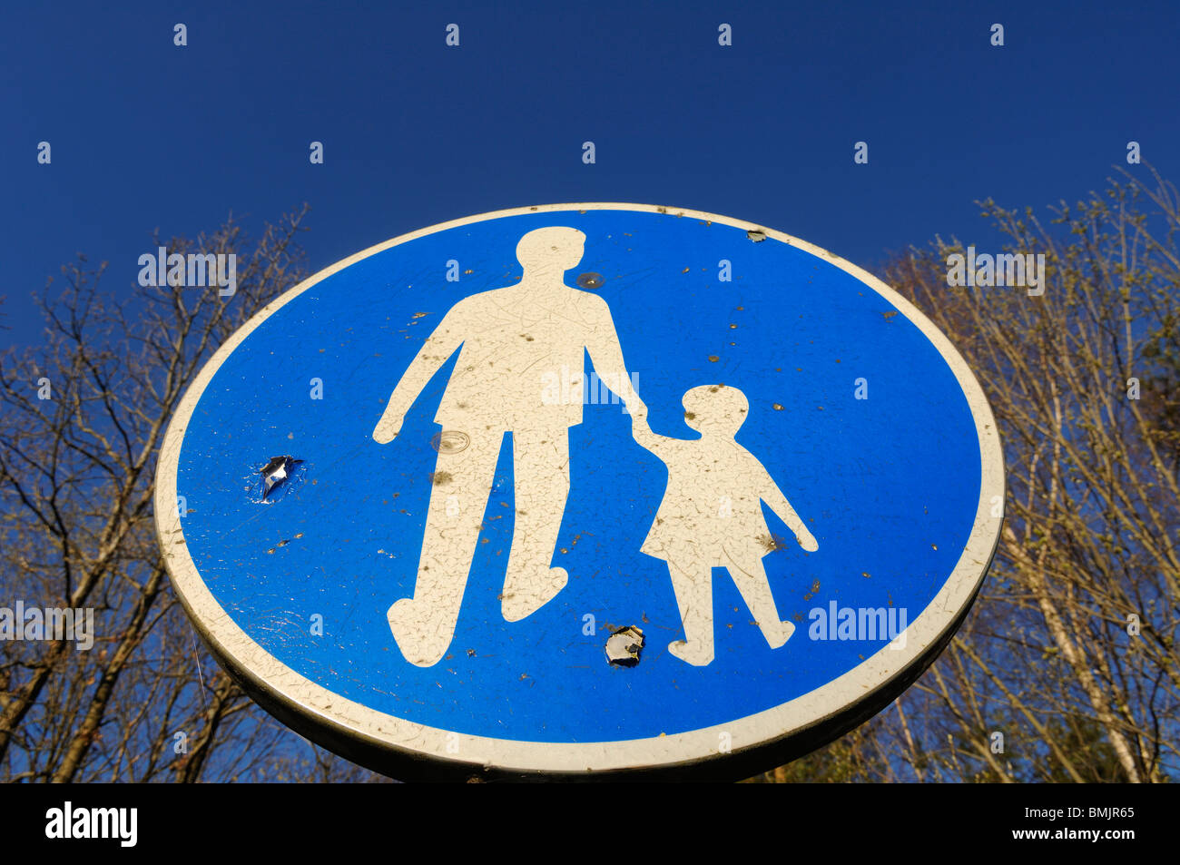 Pedestrian crossing sign, close-up, low angle view - Stock Image