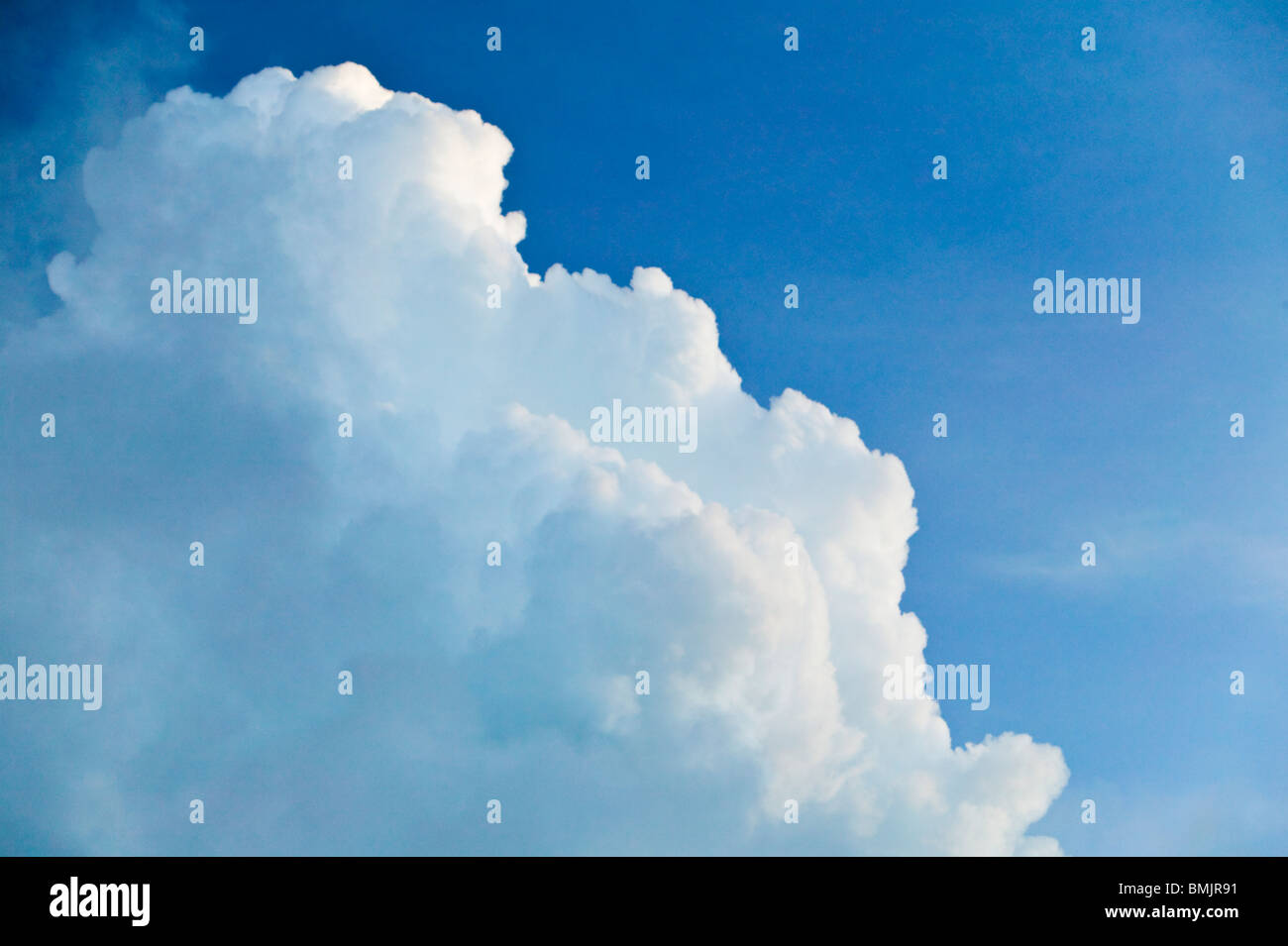 White clouds and a blue sky - Stock Image