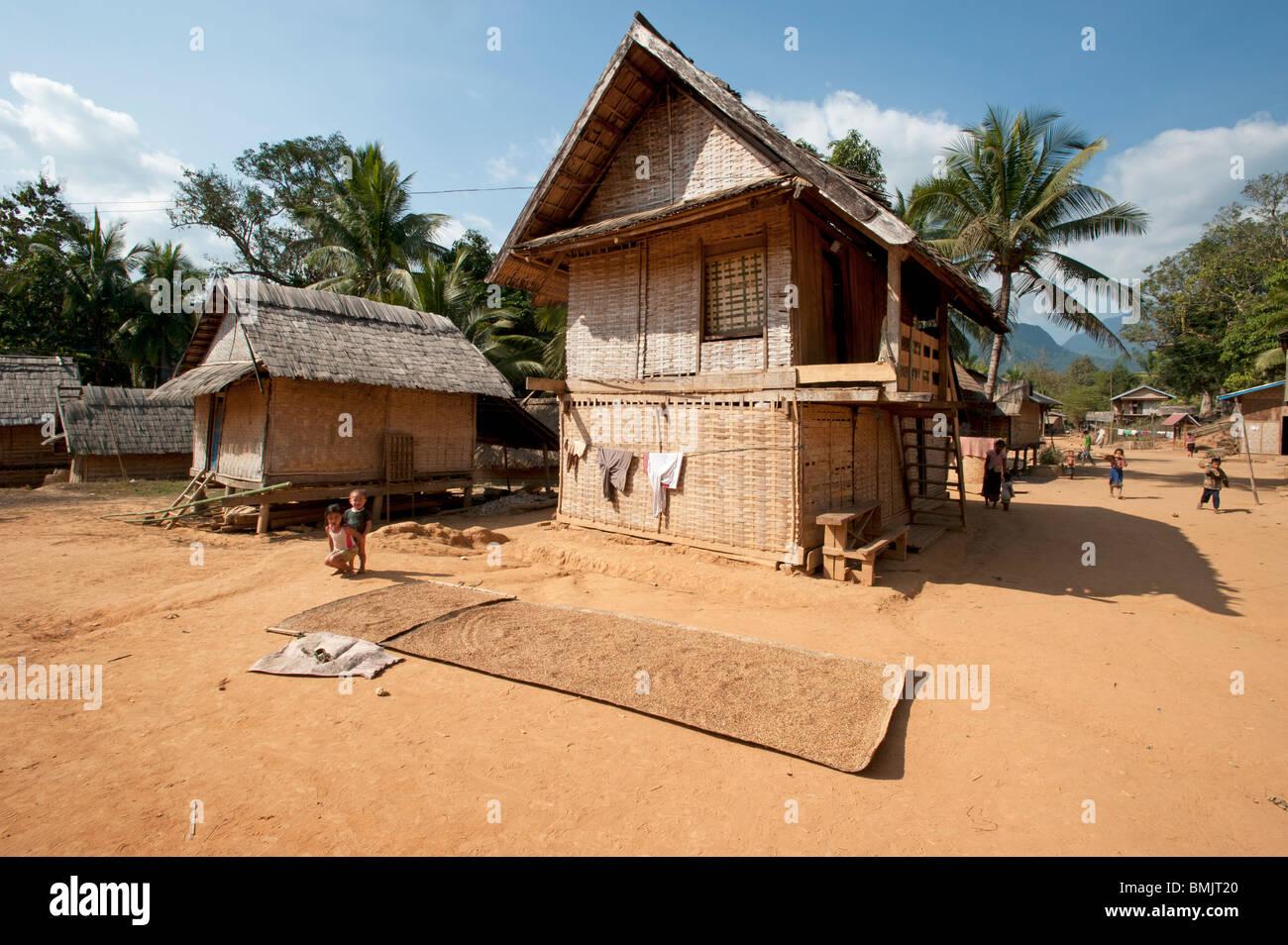 Ethnic Tribal Village Children In Front Of Their Rattan