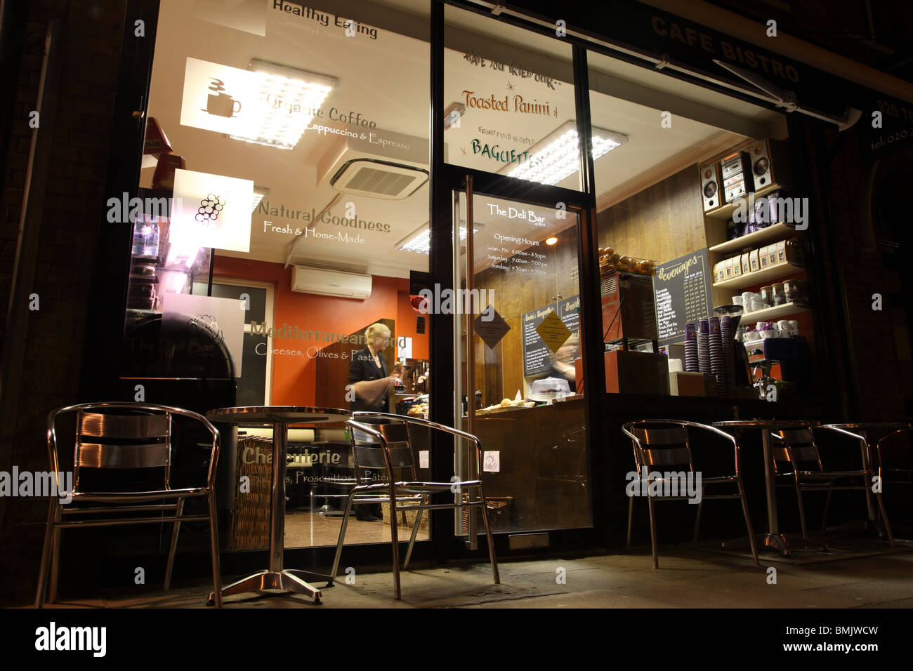 Night view of a coffee shop in West Kensington, London, W14. - Stock Image