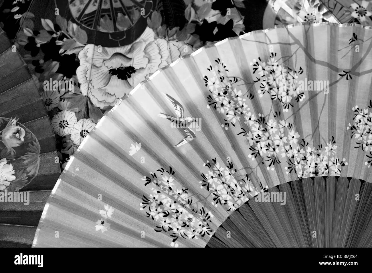 A Selection Of old Vintage Decorative silk folding Fans - Stock Image