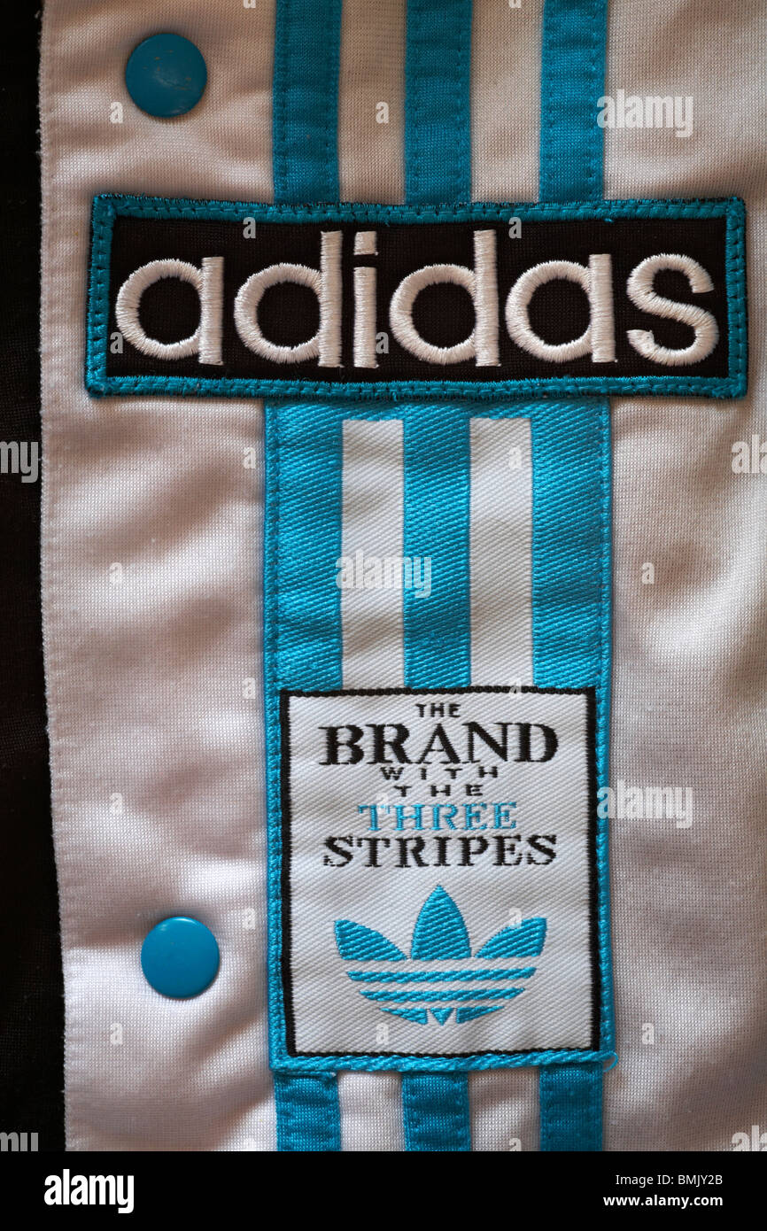 Adidas logo on tracksuit bottoms - the