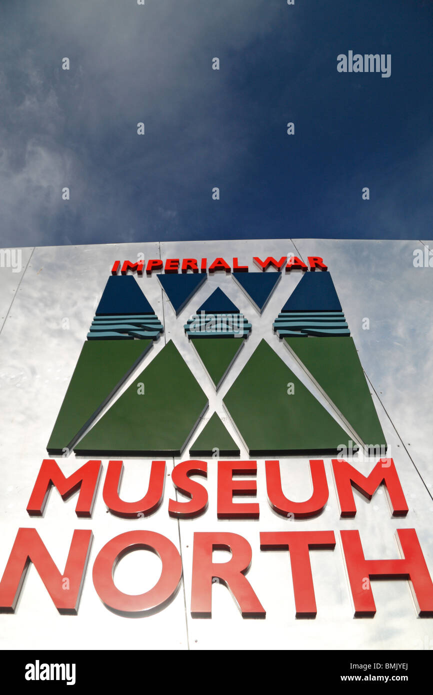 The logo and entrance sign at The Imperial War Museum North, The Quays, Salford, Manchester, UK. Stock Photo