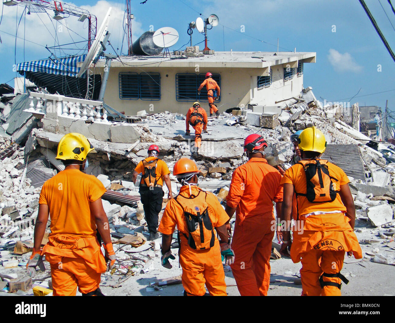 A Dominican search and rescue team searches for survivors in the rubble in Port au Prince, after the Haiti earthquake - Stock Image