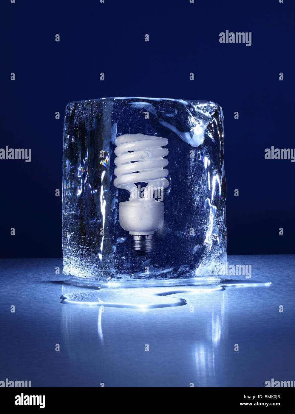 a frozen block of ice with a compact light bulb frozen inside on a