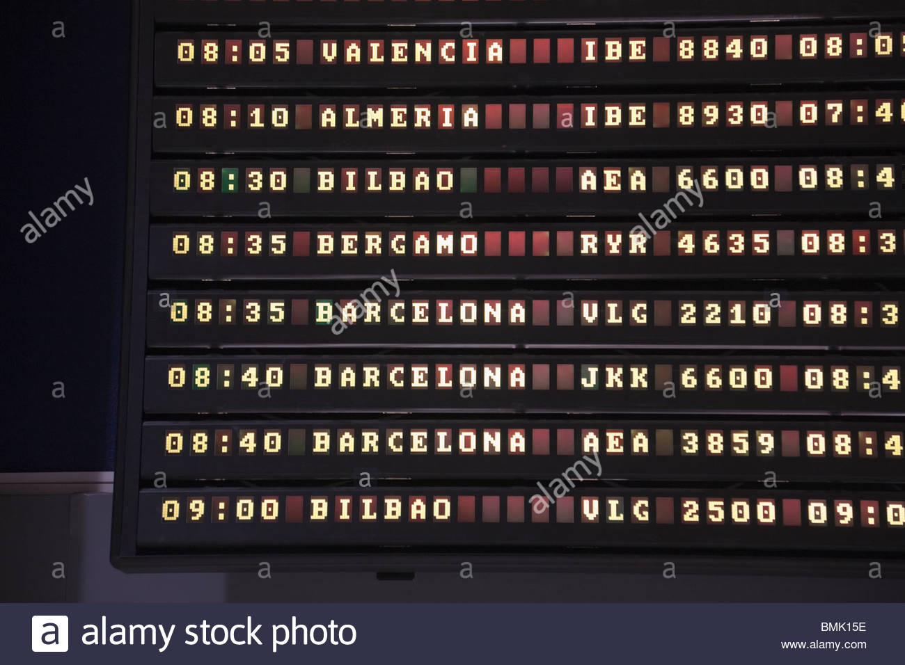 Departure board in airport - Stock Image