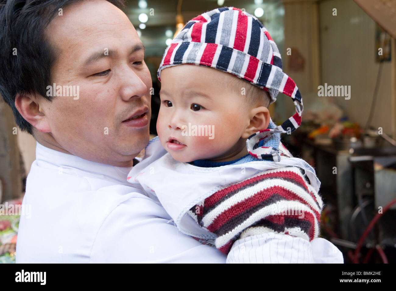Father and baby, Shanghai, China - Stock Image