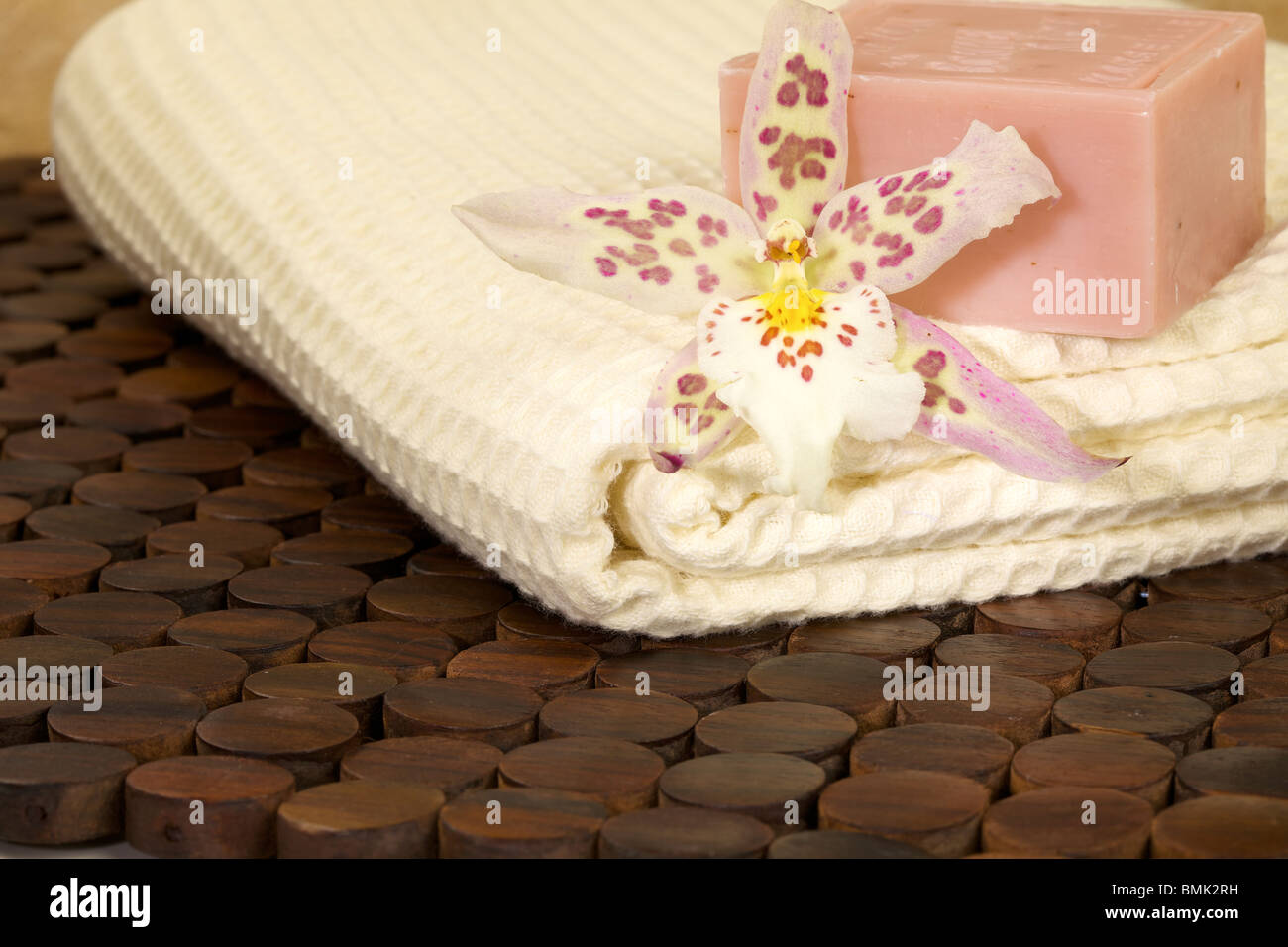 Zen-like scene with flower and candles - Stock Image