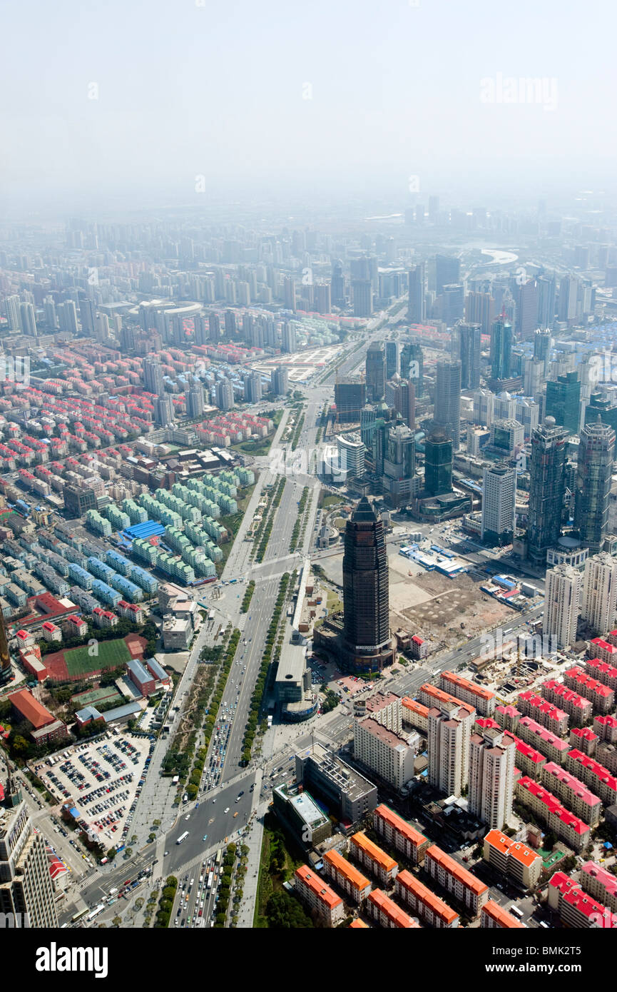 Smog and urban sprawl viewed from above, Shanghai, China - Stock Image