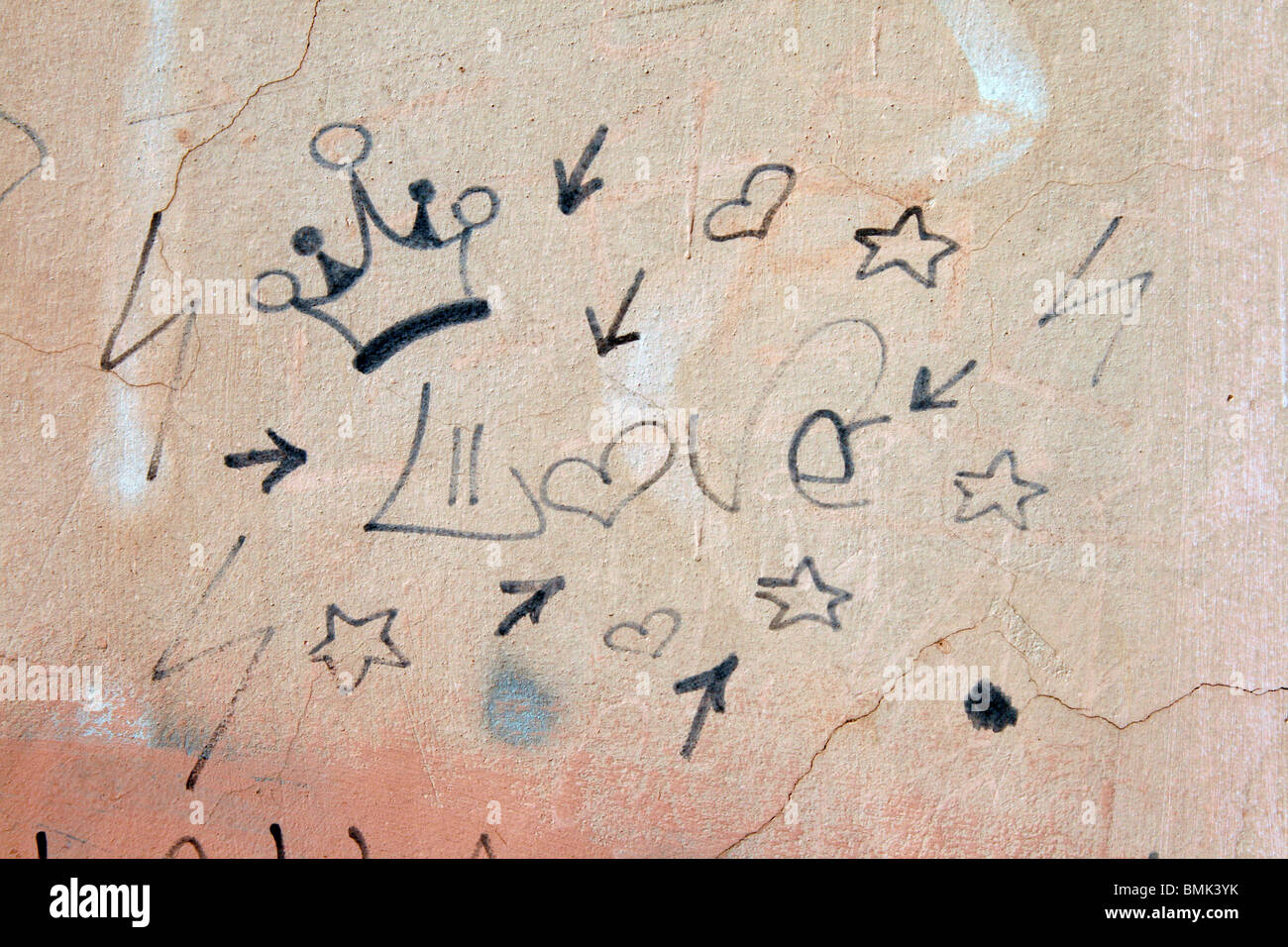 one single red love heart graffiti on brick wall in sun Stock Photo