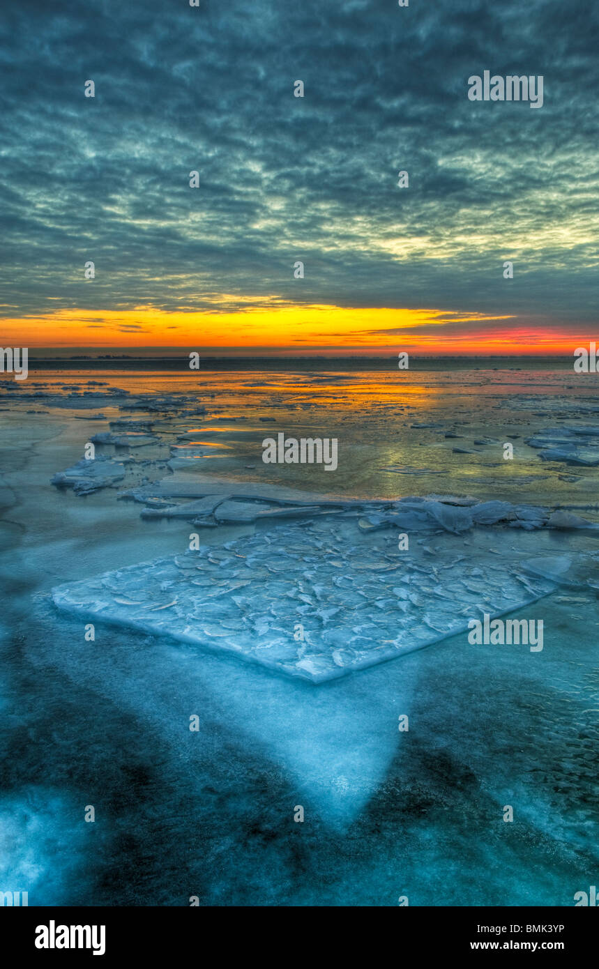 The dramatic landscape of a frozen Lake St. Clair in early morning twilight - Stock Image