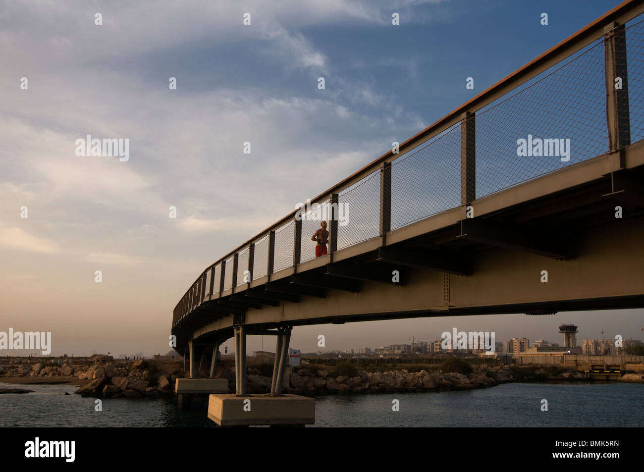 A bridge over the estuary of the Yarkon or Yarqon river which flows west through Gush Dan conurbation into the Mediterranean - Stock Image