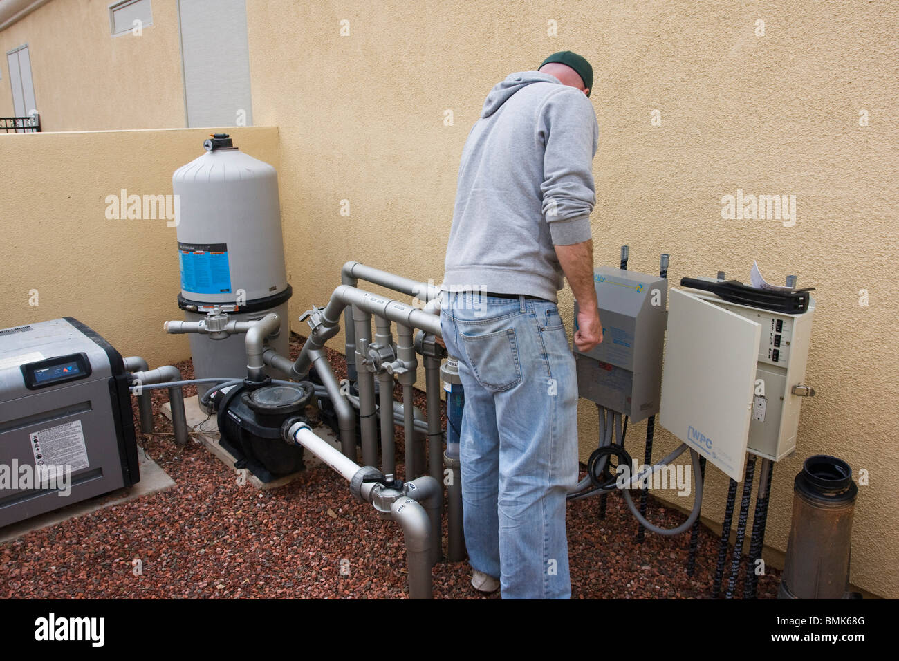 Man turning valve of a swimming pool system Stock Photo ...