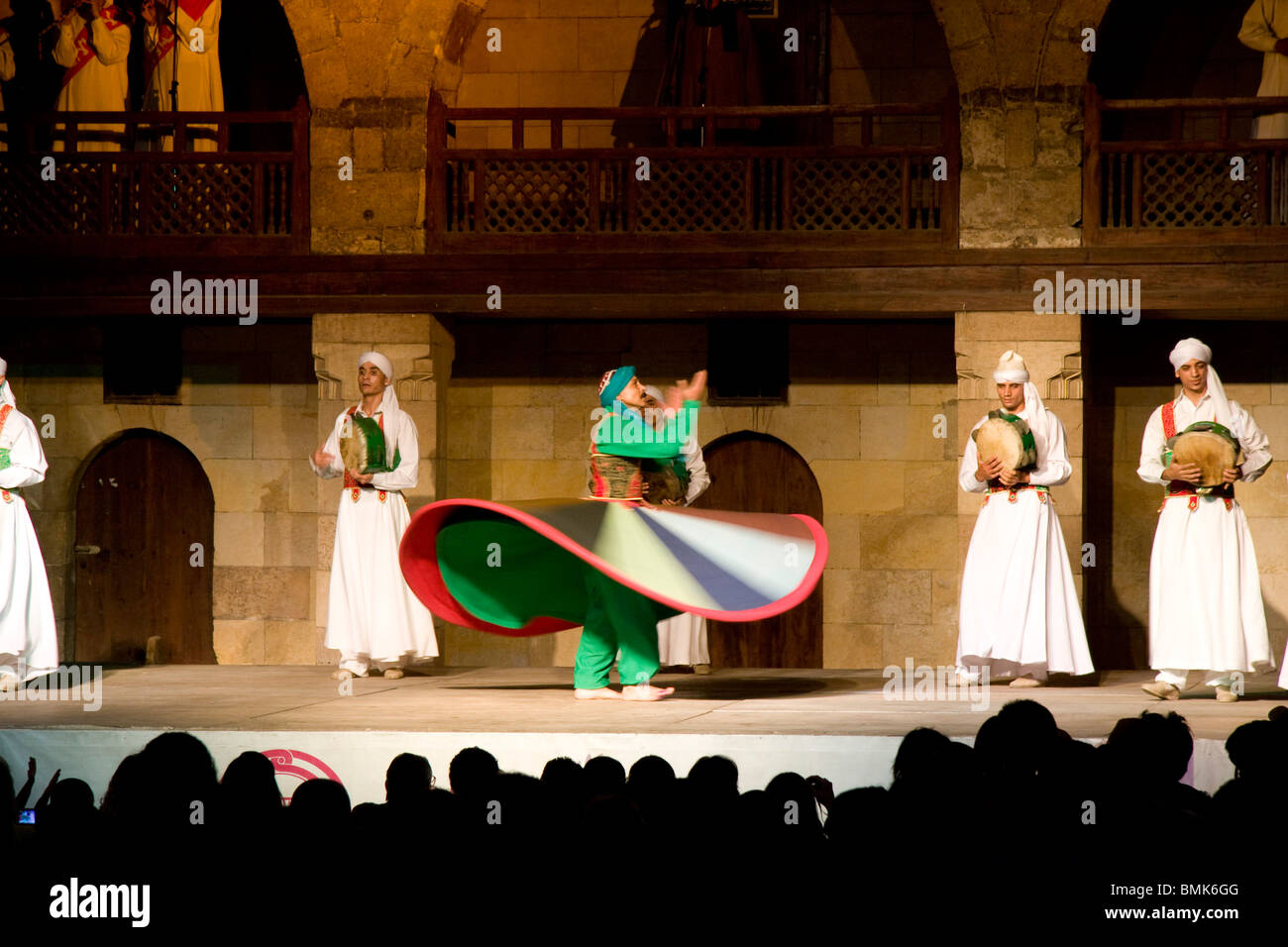 Whirling dervish performing a Sufi dance at the Al-Ghouri Mausoleum at night, Cairo, Al Qahirah, Egypt Stock Photo