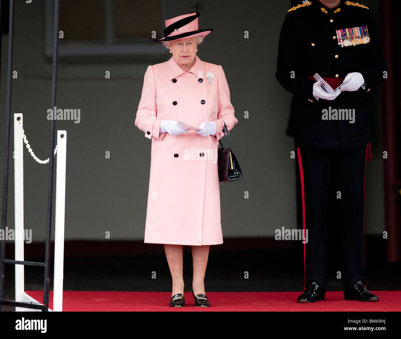 Britain's Queen Elizabeth II at the Drumhead Service and Afghanistan service medal to the 1st Battalion the - Stock Image