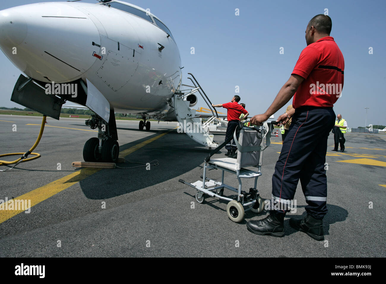 Disabled persons disembarking - Stock Image
