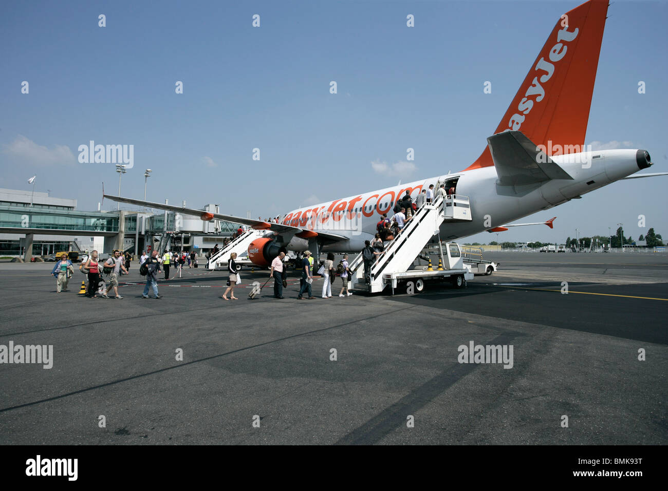 Passengers boarding an airplane - Stock Image