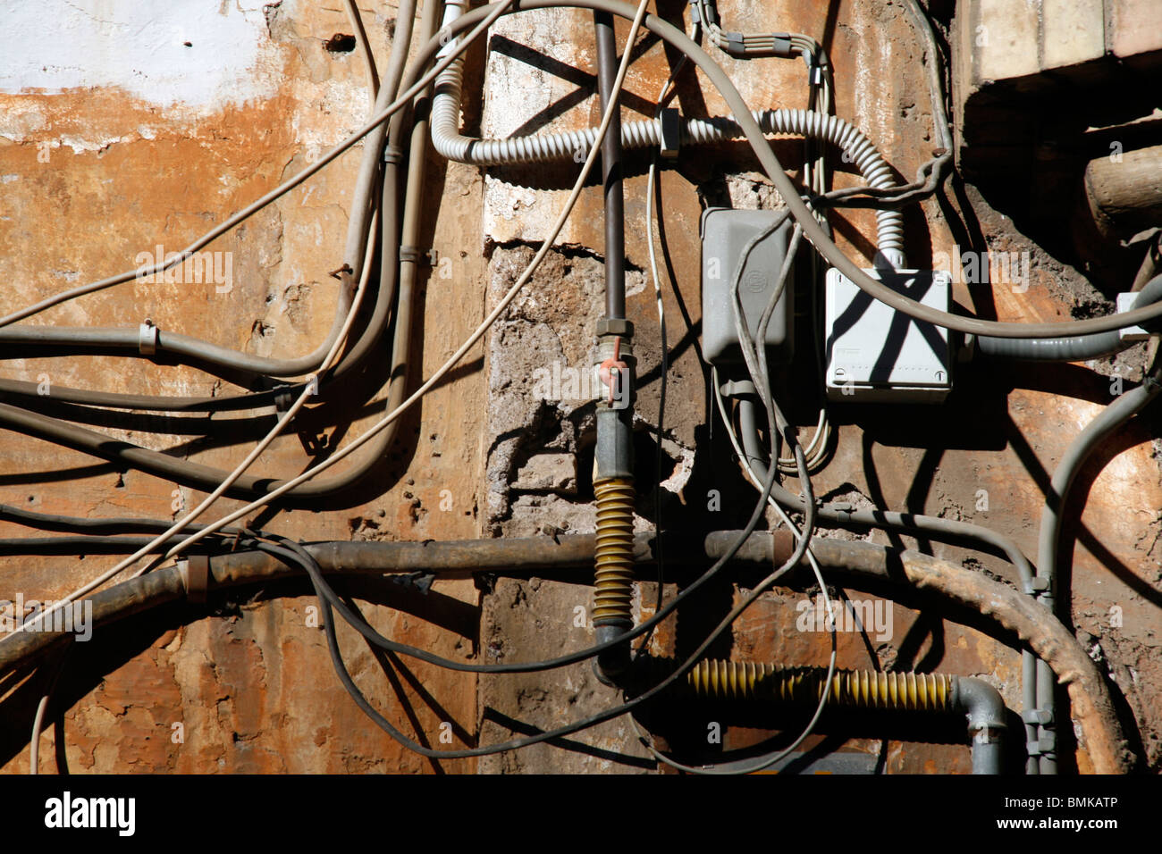 electricity power wiring circuit cables tubes on side of property ...