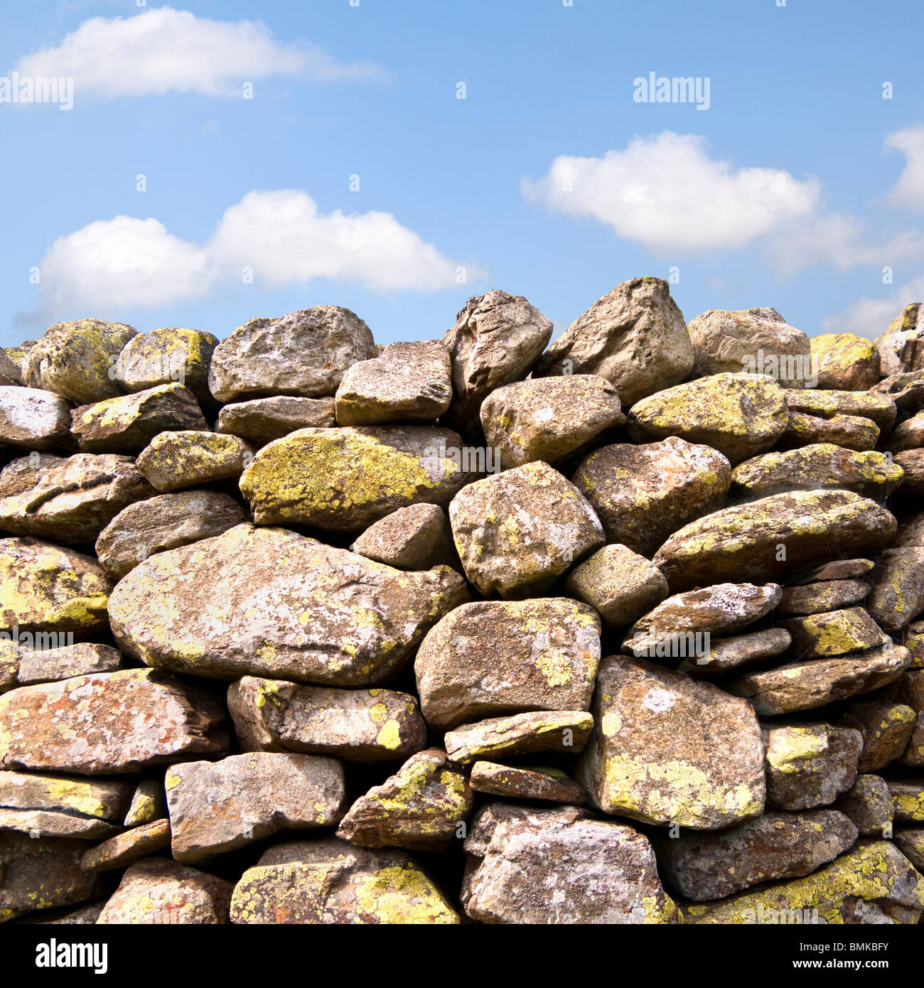 Dry stone wall detail with blue sky England UK - Stock Image