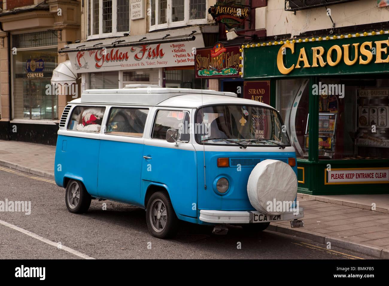 UK, England, Devon, Brixham Harbour, Volkswagen Camper Van parked outside takeaway food shops - Stock Image