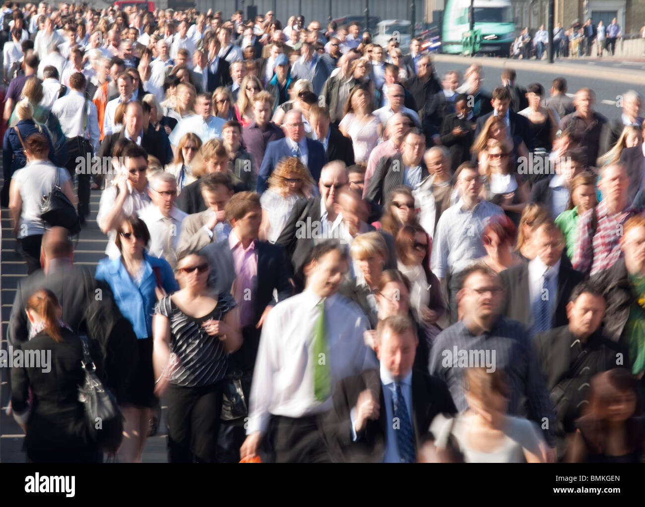 Commuters on London Bridge during rush hour - Stock Image