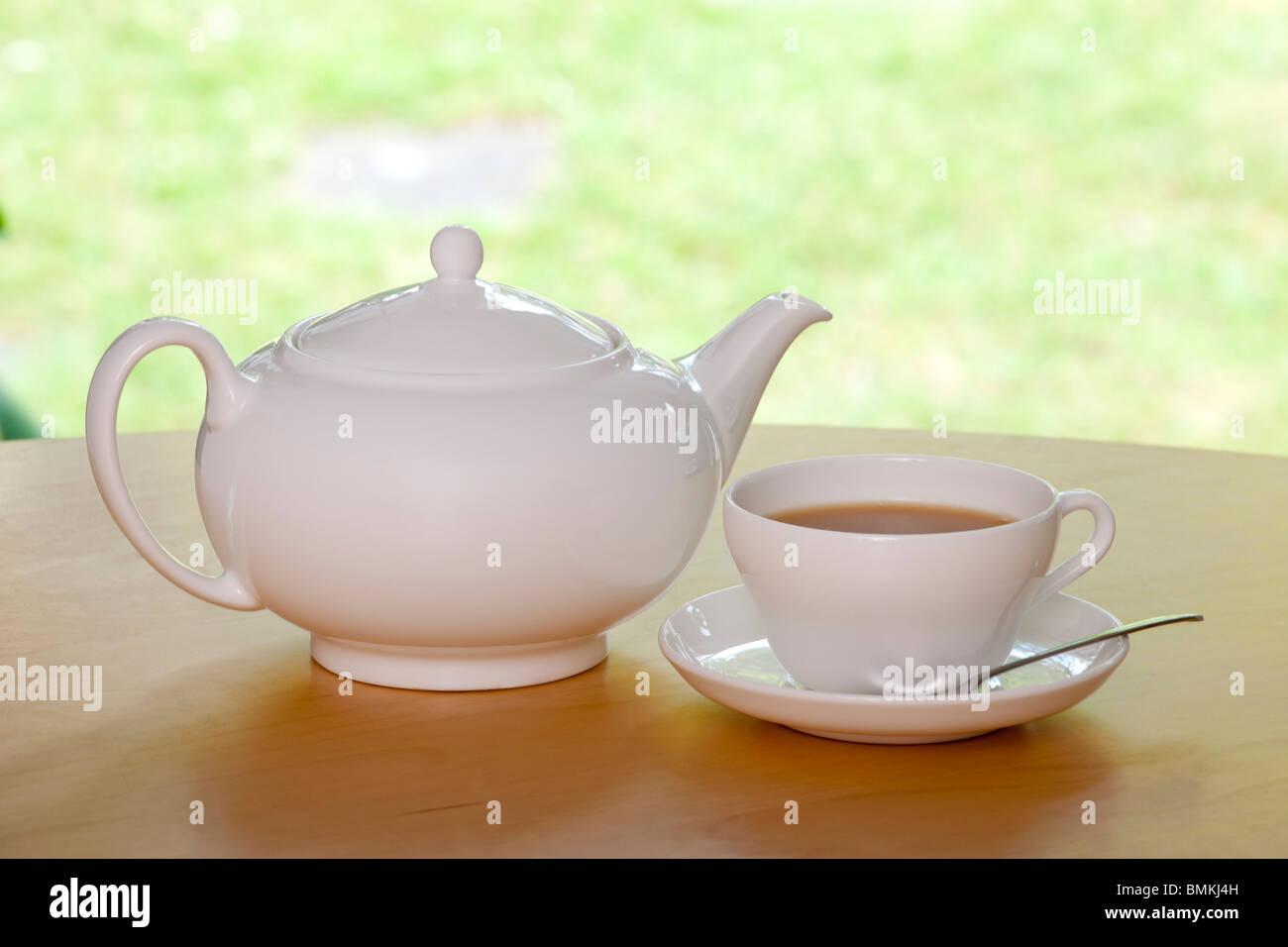 Tea Pot & Cup - Stock Image
