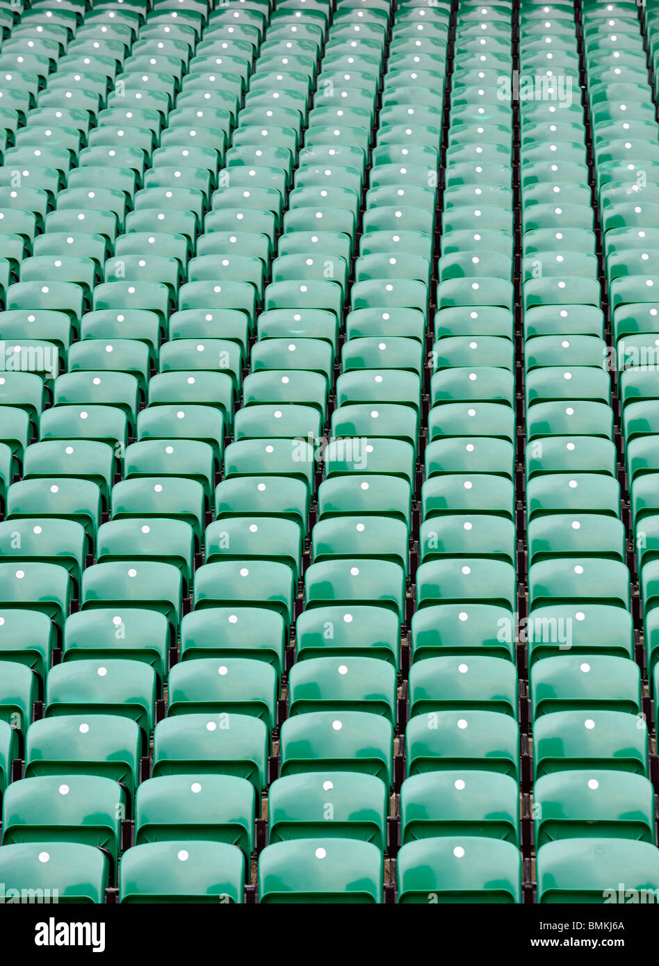 rows of green seats at Twickenham Stadium, the home of English Rugby - Stock Image