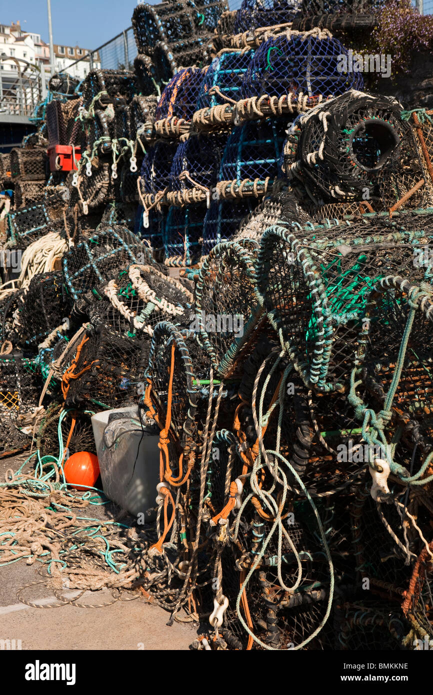 UK, England, Devon, Brixham fishing Industry lobster pots on the quayside - Stock Image