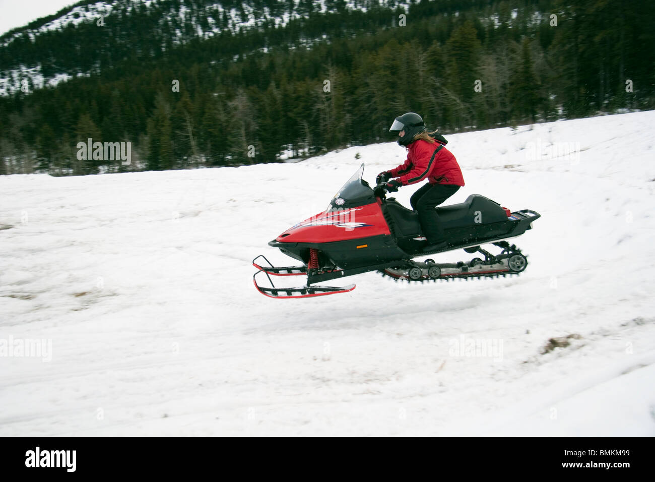 Snowmobile In The Air - Stock Image