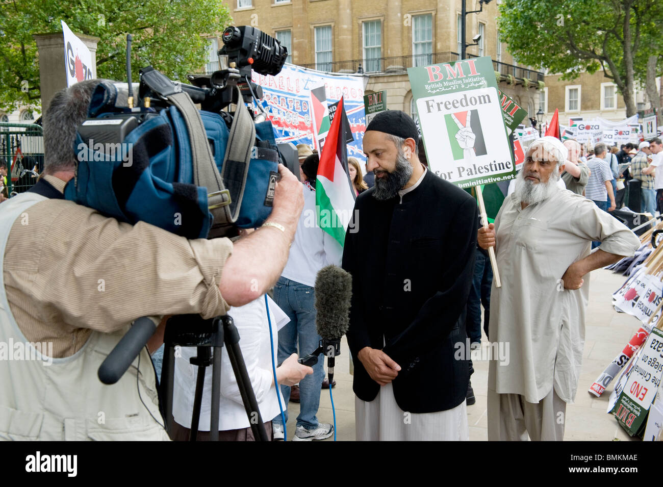 Ismail Patel, chairman of Friends of Al-Aqsa,  talks to TV crew during Free Gaza demonstration in Whitehall , June - Stock Image