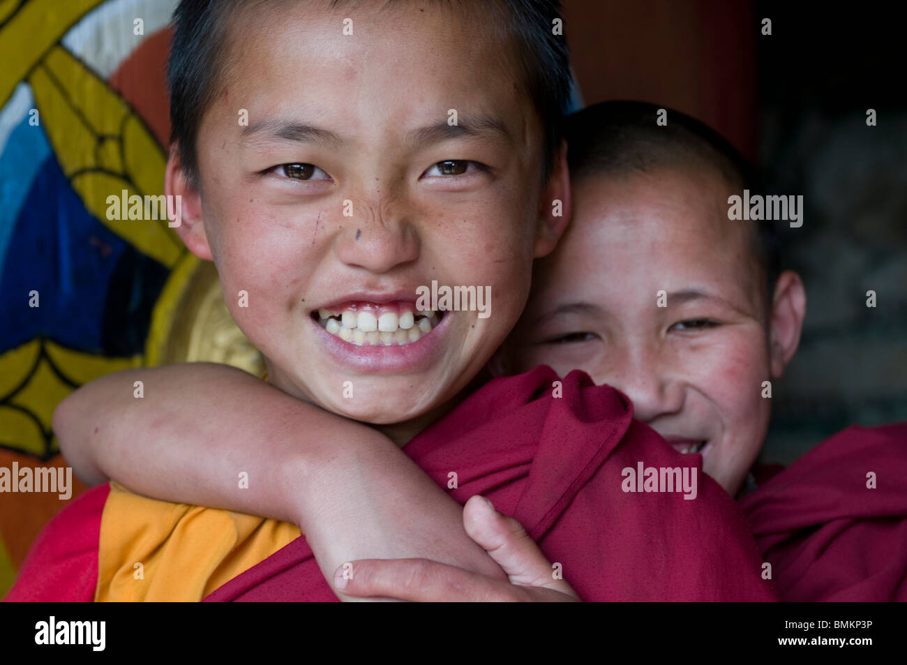 Very young, happy, buddhist monks. Chimi Lhakhang. Bhutan. Asia. - Stock Image