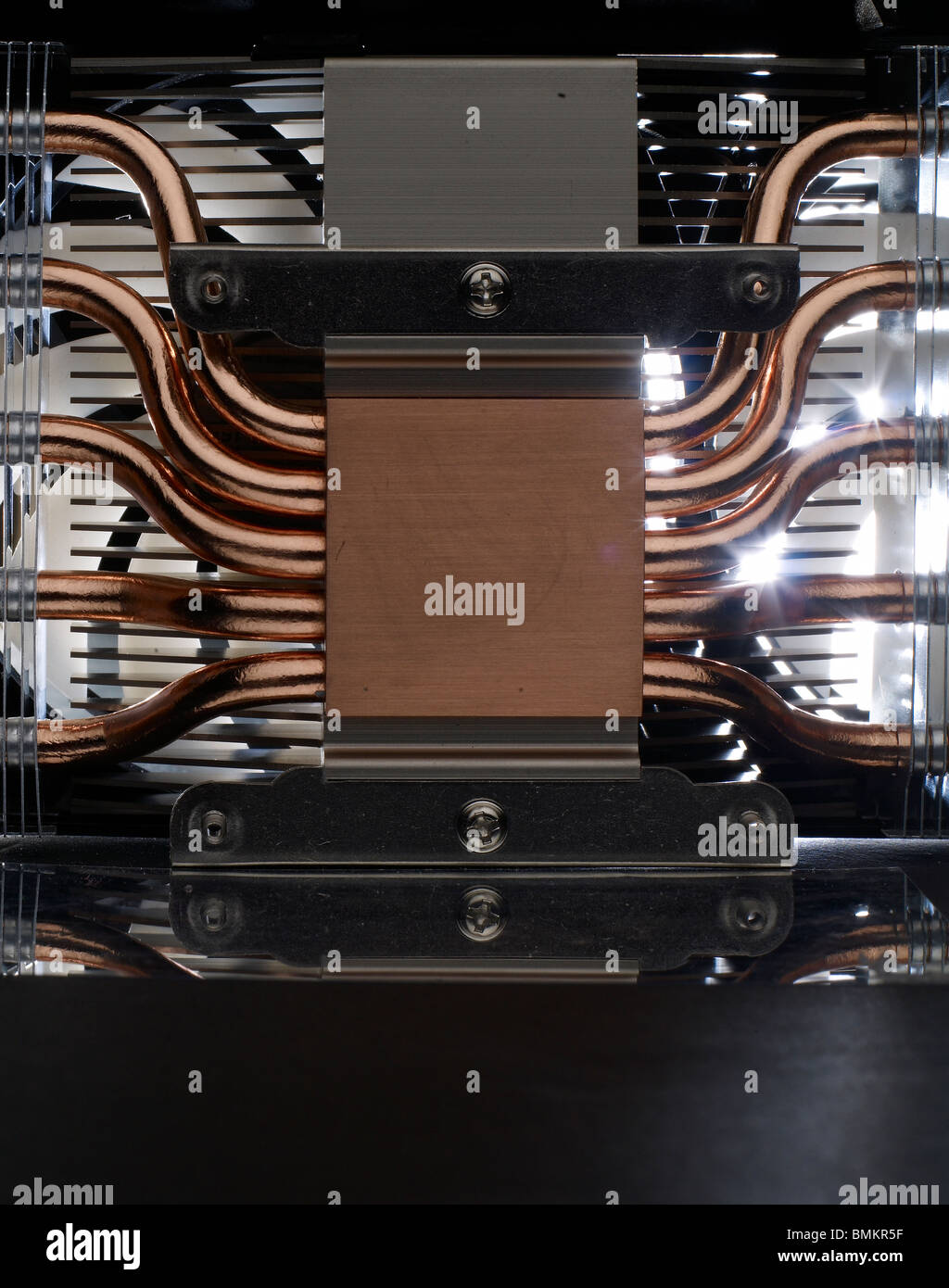 Copper metal heat sink and fans of liquid cooled computer card - Stock Image