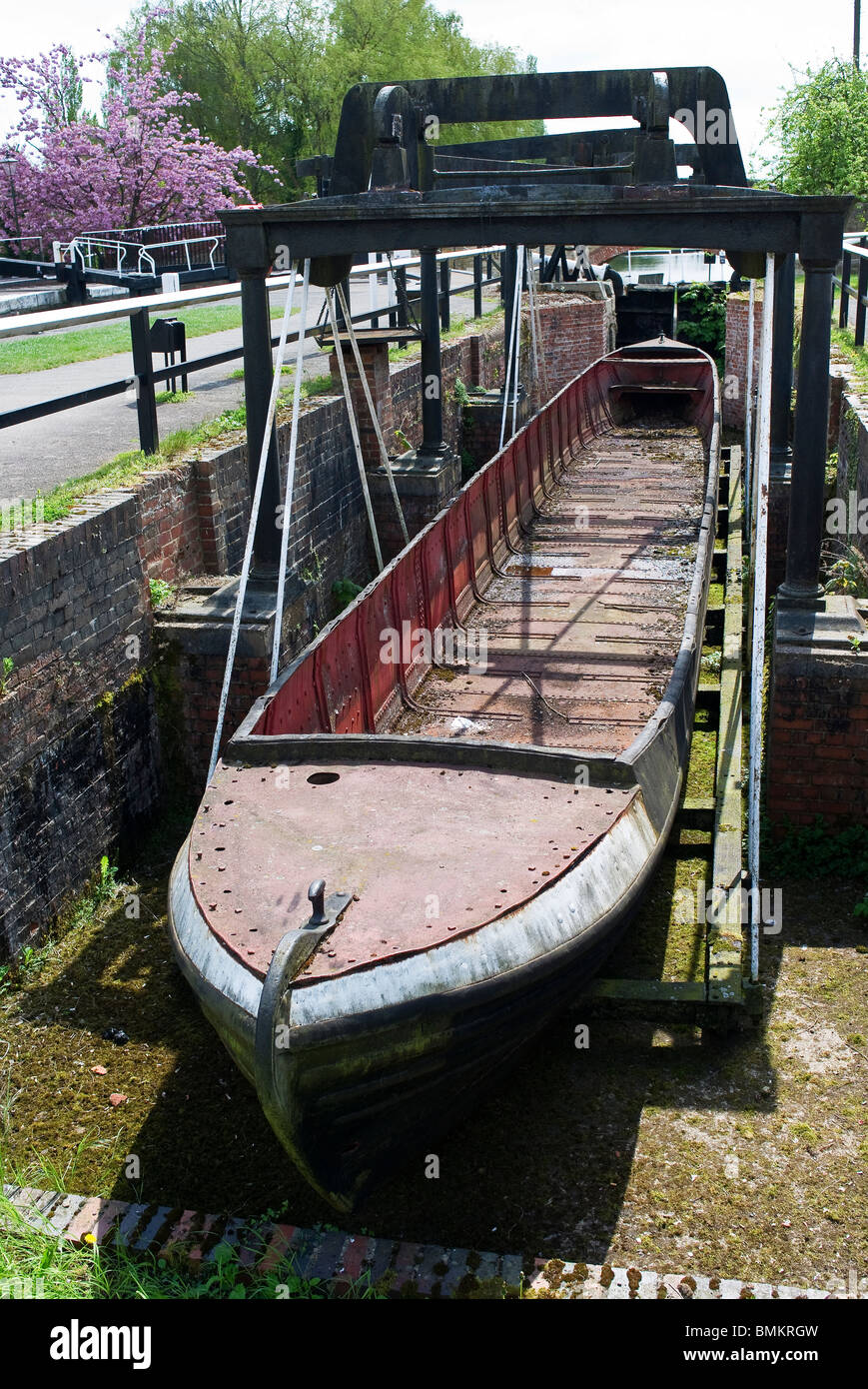 Old canal barge in dry dock at Stoke Bruerne UK - Stock Image