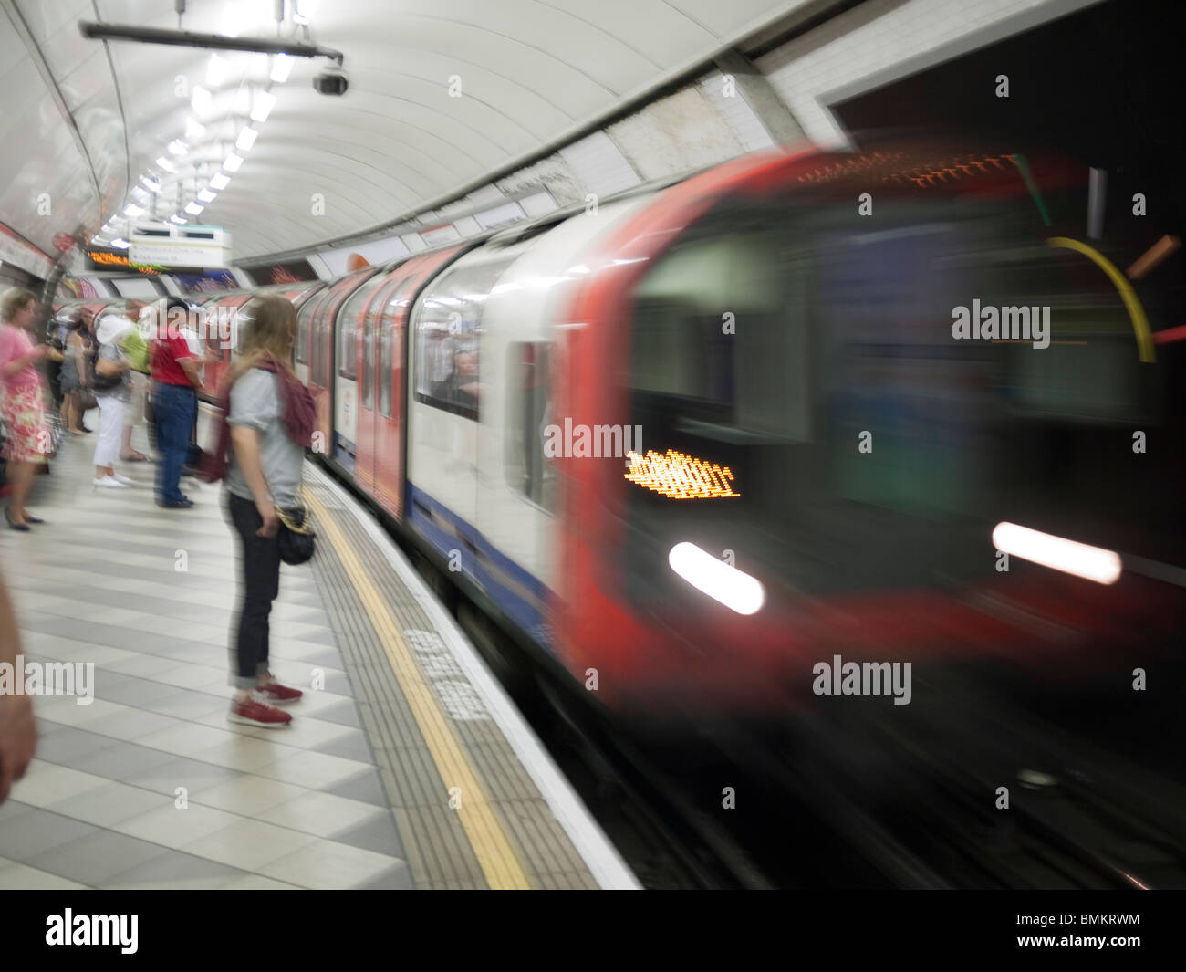 London Underground train arriving at station - Stock Image
