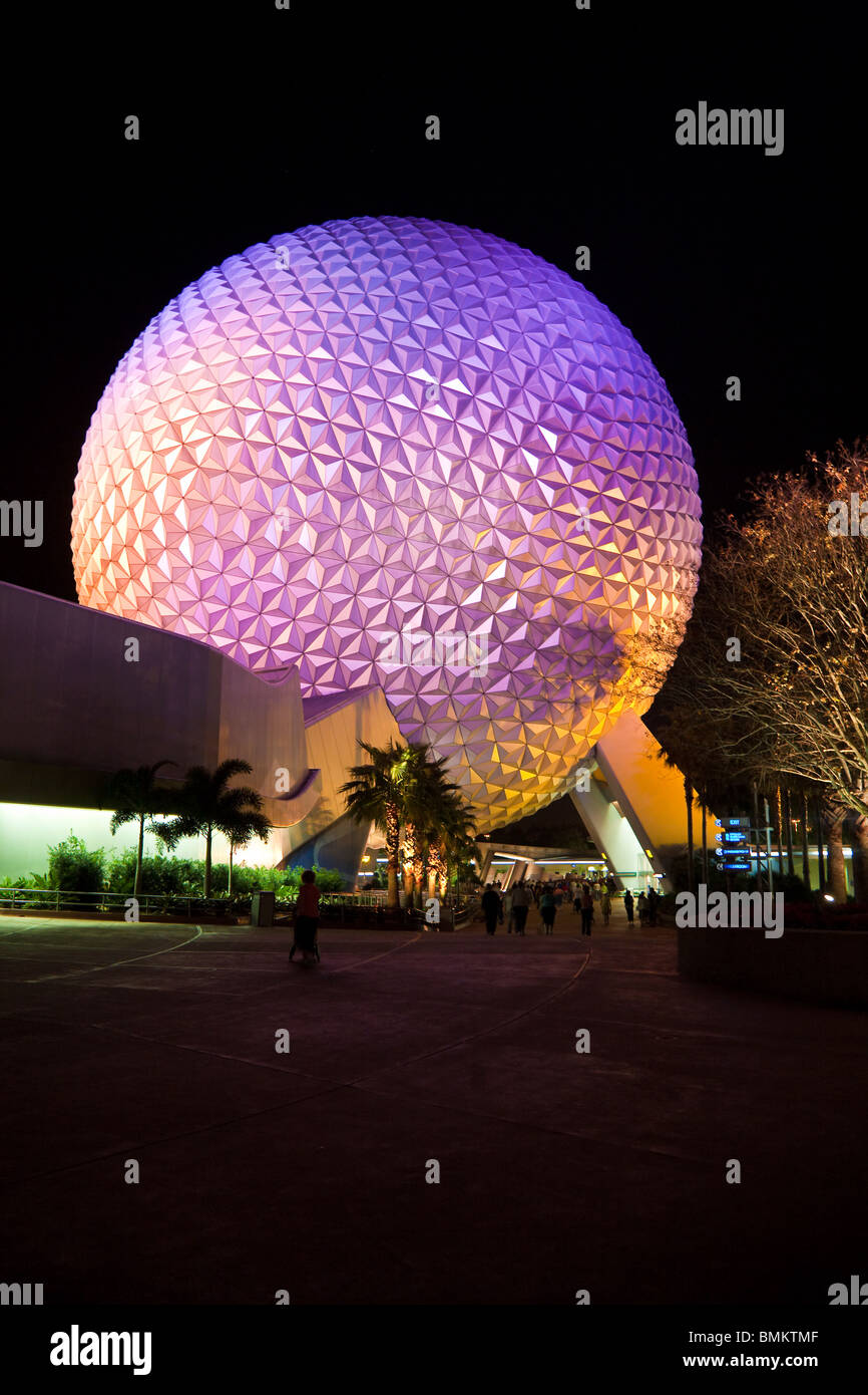 Geodesic dome of Spaceship Earth attraction lit with purple lights at night in Walt Disney's Epcot Center - Stock Image