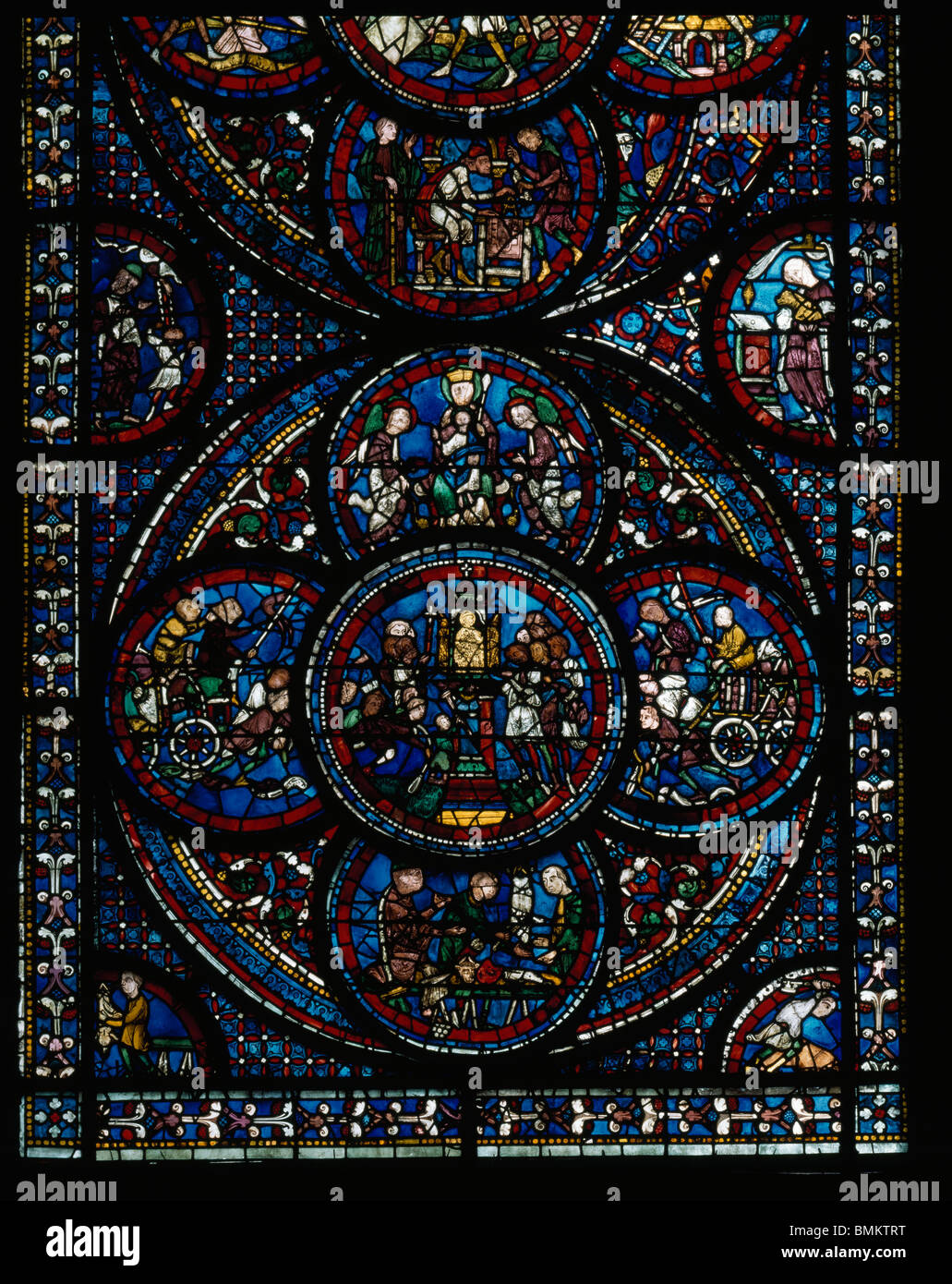 Chartres Cathedral of Notre Dame. France. Miracles of Virgin window roundel shows the Cult of the Carts - Stock Image