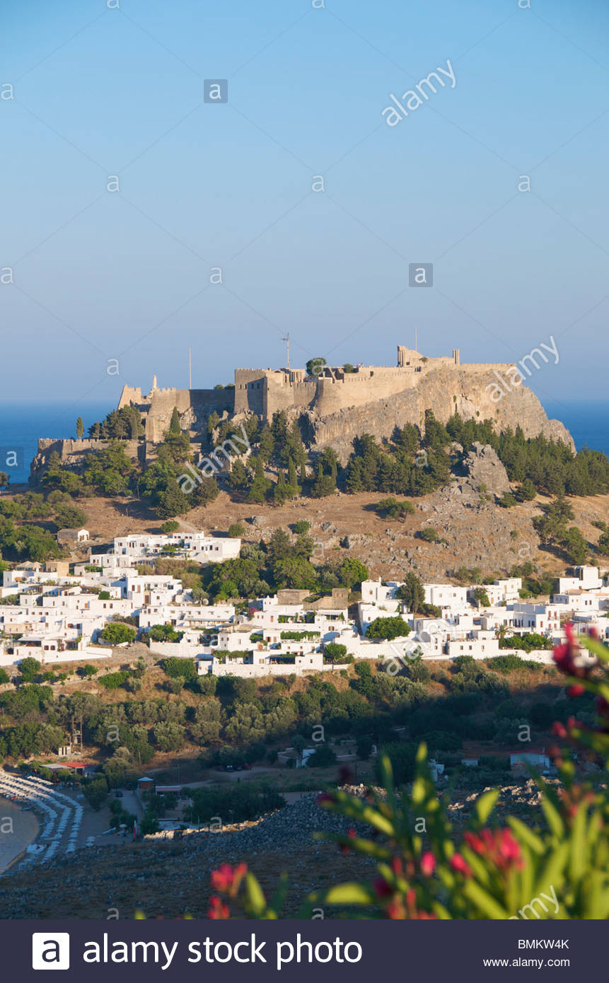 View of town and Acropolis Lindos Rhodes Greek Islands Greece - Stock Image