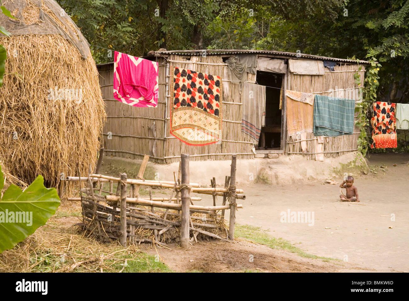 Rural scene hanging cloths on rope ; village Tauta; district Manikgunj ; Bangladesh - Stock Image