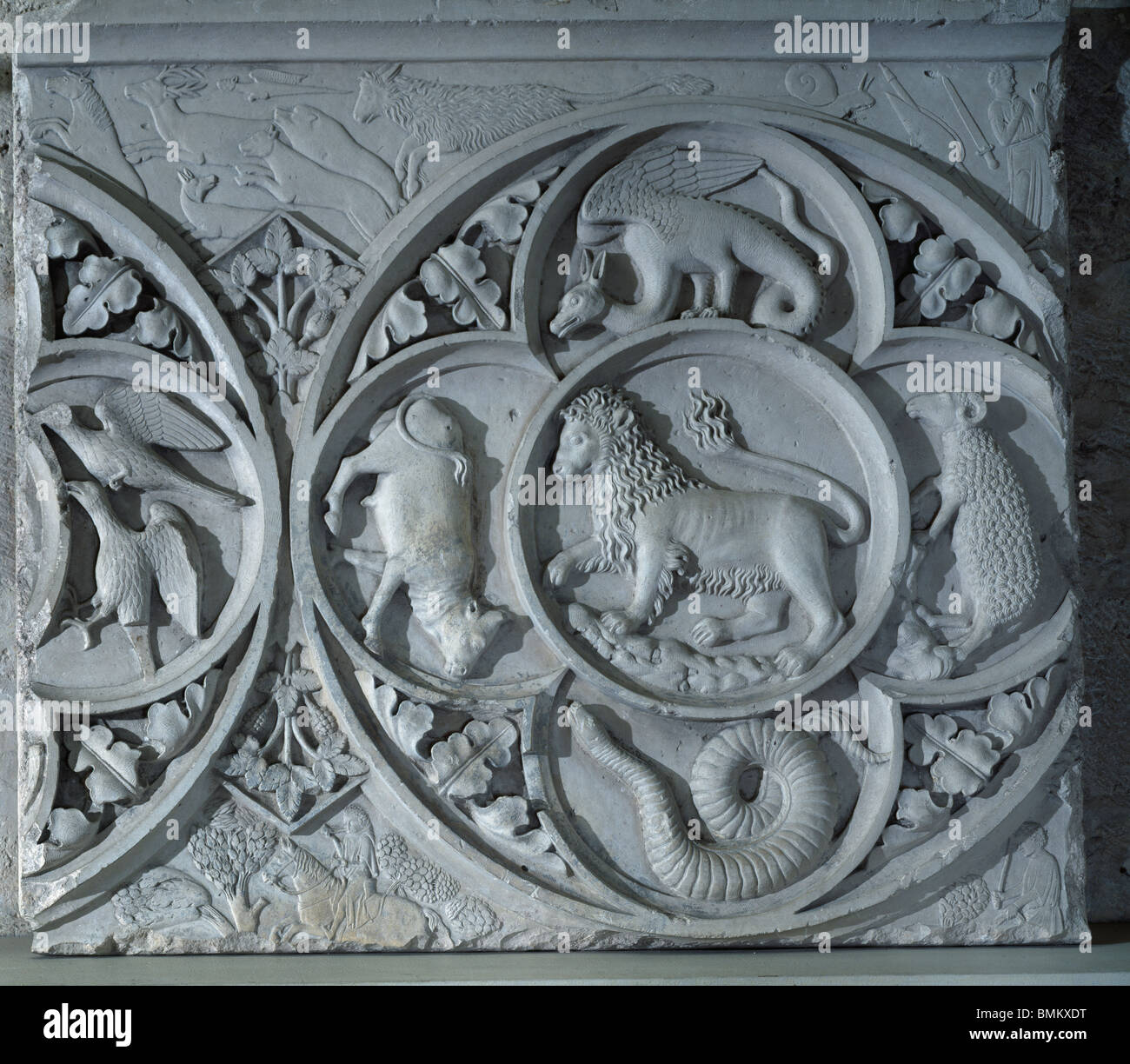 Chartres Cathedral of Notre Dame. France. Fragment from the destroyed 'jube', c. 1220. Hunting scenes and roundel Stock Photo