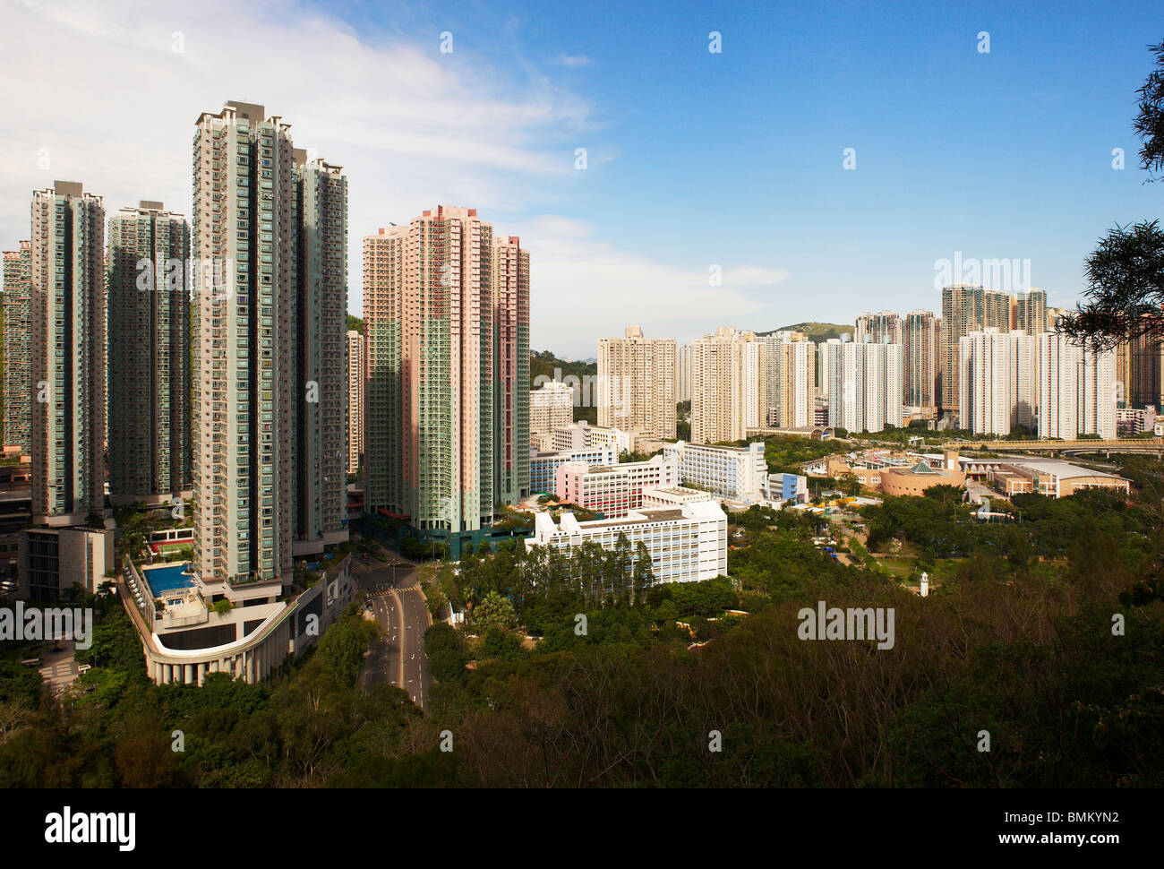 """High apartment buildings densely packed together, forming """"wall blocks"""" on the mountain side, providing shelter Stock Photo"""