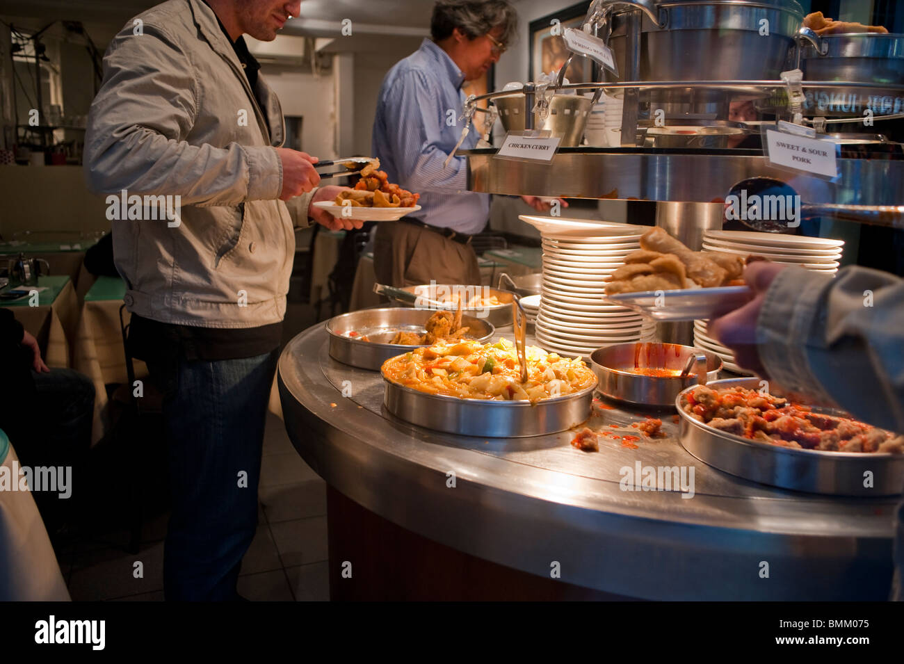 London, UK, Chinatown, Chinese Restaurant, Customers Serving Themselves at Chinese Food Buffet - Stock Image
