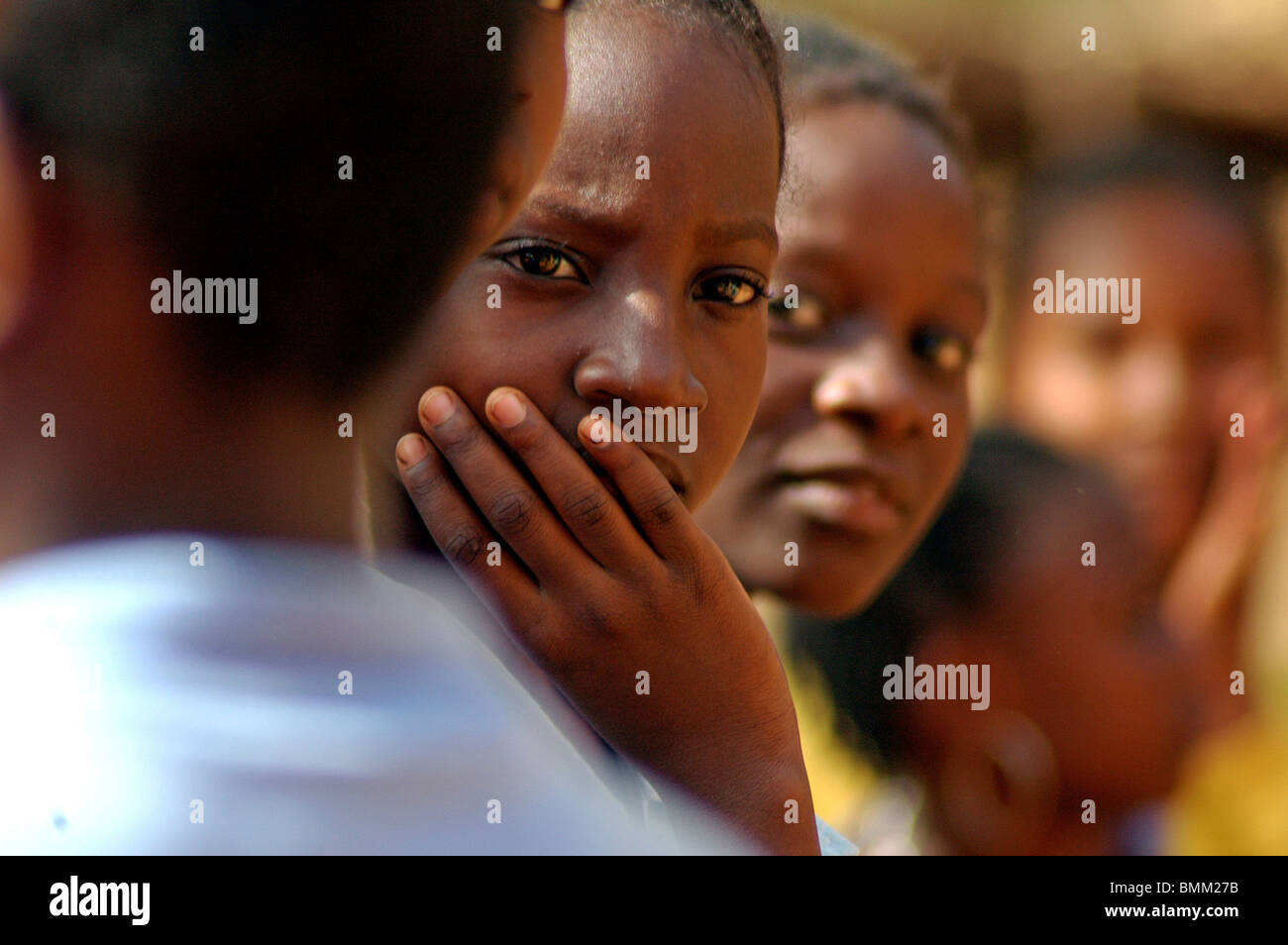 Niger, Niamey, Portrait of african adolescent girls with traditionnal plaits - Stock Image
