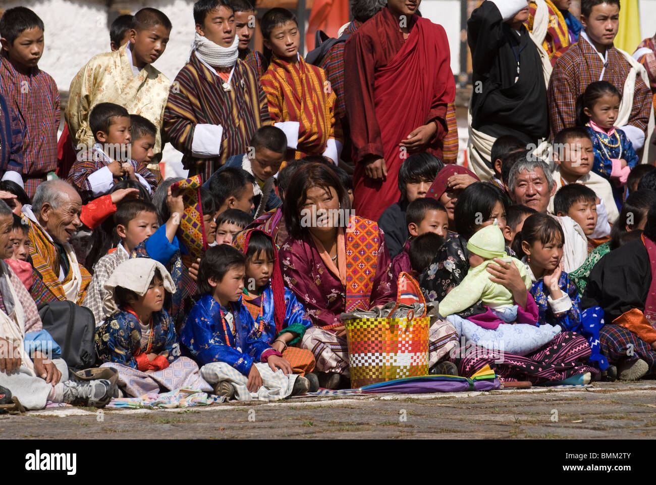 Religious festivity with man visitors and dances,Paro,Tsechu,Bhutan,Asia - Stock Image