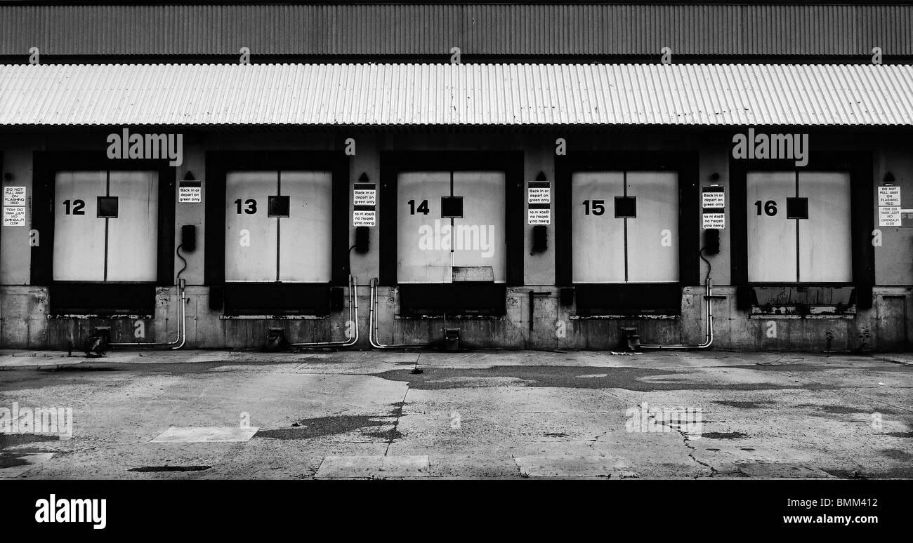 Five abandoned truck loading docks. - Stock Image